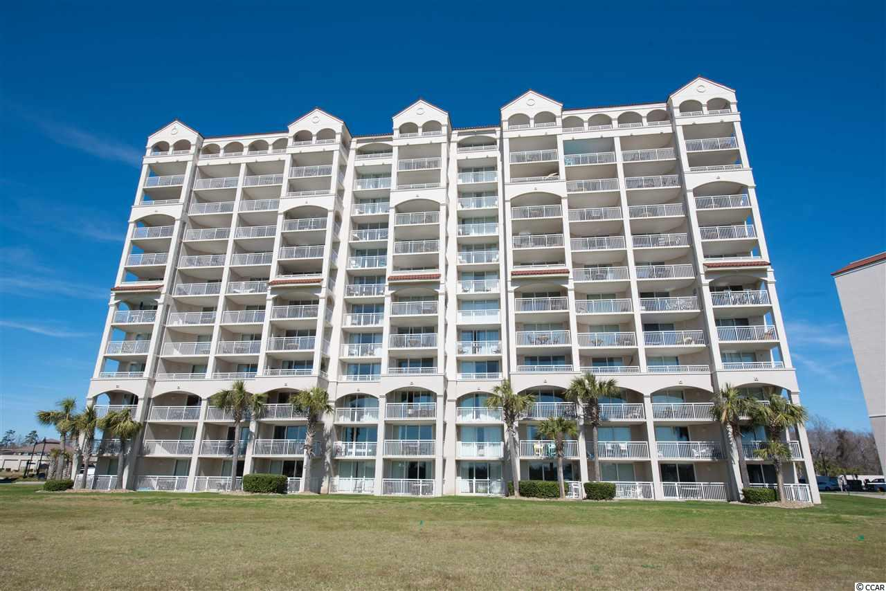 This amazing 2200-square-foot unit, in North Myrtle Beach, offers gorgeous views of the Intracoastal Waterway and the marina. Walk or bike to local community events, eateries or simply enjoy adventuring around this well laid-out enclave.The community of Yacht Club, at Barefoot Resort, is coveted by many, as it is a prime development offering amenities such as top-rated golf courses and a gated parking lot for extra assurance. Enjoy access to the nearby pool with your HOA key. This spectacular end unit, faces north, allowing for glorious sunsets and sunrises to be savored right from the covered balcony- which is ideal for year-round enjoyment and safety. Walking in, you are greeted by beautiful tiling that boasts an artful nautical design accent. The openness and spaciousness of the well-maintained condo will have you feeling like you are living a vacation daily. A living room, with recently added TV mounts, is the perfect place to enjoy a movie with close friends. In 2015, upgrades such as new carpet, new paint, new stainless steel refrigerator and new dishwasher were added to the breathtaking space. All towel bars, cabinet hardware, kitchen faucet and disposal have been replaced. The eat-in kitchen boasts a dual sink, tray ceiling, plenty of cabinetry, space for meal prep, gleaming granite counter tops and a lovely bar to enjoy casual meals. A quaint dining area is extremely inviting and light-filled. A master bathroom offers his and her vanities, roomy tub for soaking and separate shower. Villa 1, where this 3-bedroom/3-bathroom is located, is truly prized as it's closest to the pool and offers breathtaking views from every window. Experience an island-lifestyle, while still having access to incredible entertainment and cuisine. The HOA management company does a lovely job keeping things running smoothly. Building managers and security have offices on site. Peaceful, luxurious and incredibly affordable, this property will not stay on the market for long. If cravin