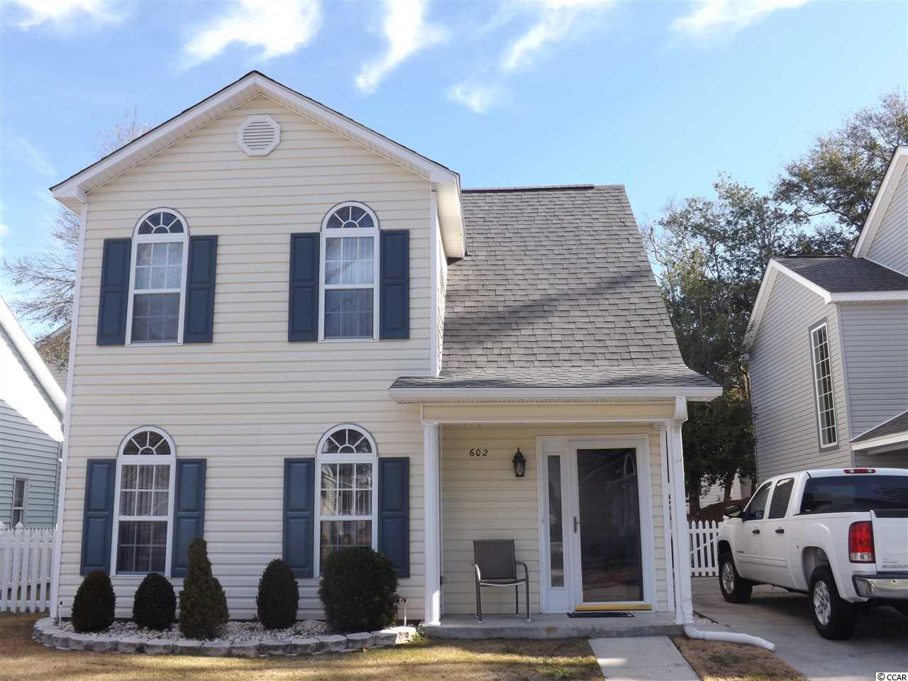 This traditional style home is well maintained and located in a quiet neighborhood. The seller is the original owner. The roof was recently replaced(11/18) and there is NO HOA fee. The home is not in a flood zone.  The finishes in the living room include crown molding and a chair rail.  The back of the house has a spacious Carolina Room with plenty of natural light. A large master bedroom with a walk-in closet, with crown molding, and a full bath are located on the first floor.  The upstairs has two spacious bedrooms that include walk in closets, with a very large Jack and Jill bath that inludes two sinks and a tub/shower.  The 2nd upstairs bedroom has a spacious owner's closet that could be another oversized walk-in closet. You can be on the beautiful beach or Main Street in Ocean Drive within five minutes.  Upgraded Hunter ceiling fans have been installed throughout the home; kitchen contains an electric stove, new microwave, dishwasher, refigerator and garbage disposal.  Remaining furniture may be purchased upon negotiations. The backyard and sideyard are enclosed with vinyl fencing.  The driveway can accommodate two cars.  A sprinkler sytem has also been installed. The HVAC sytem is 4 years old, electric water heater is 3 years old and washer/dryer are 3 years old.  The home is conveniently located to shopping, dining, golf and many attractions in North Myrtle Beach and Ocean Drive Beach. Square footage is approximate.  Have buyers and buyer agents verify.