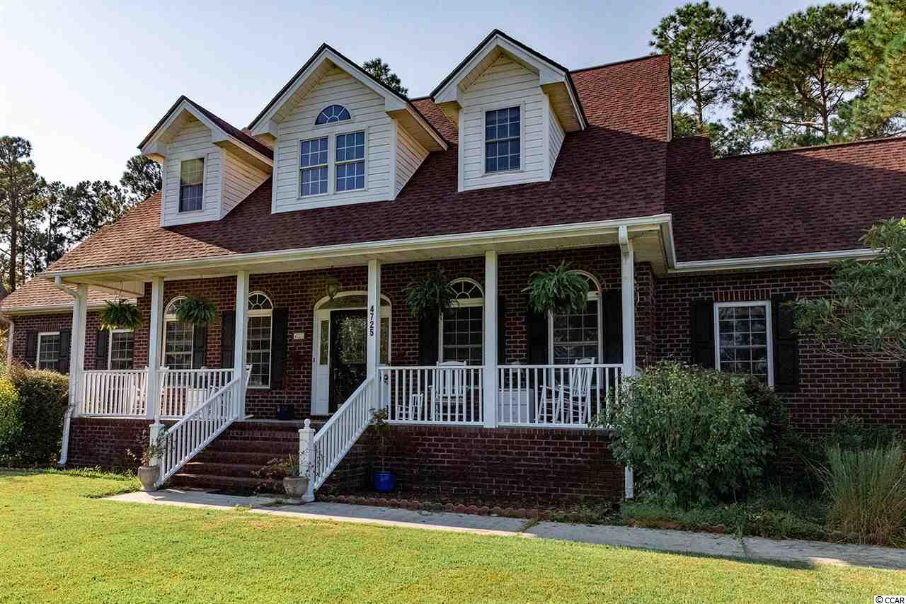 CHECK THIS HOME OUT!!! Gracious  5 Bedroom brick home on .56 acre lot overlooking Myrtle Beach National Golf Course.  Featuring a First floor master suite with all the details, Formal dining room, Den/home office with built-ins. Sun- filled kitchen upgraded with all new stainless steel appliances July/2019.  All appliances including washer/dryer convey.  A second floor master suite with an additional  3  bedrooms and walk-in attic storage.  This home has beautiful hardwood floors, crown molding, fireplace and so much more.  Even a front porch for the rocking chairs.  Roof replaced 2017.  The Community offers neighborhood pool, tennis, golf and more.   Close  to shopping and dining, medical facilities, colleges and schools and beaches.    All measurements are approximate and not guaranteed.  Buyer is responsible for verification.