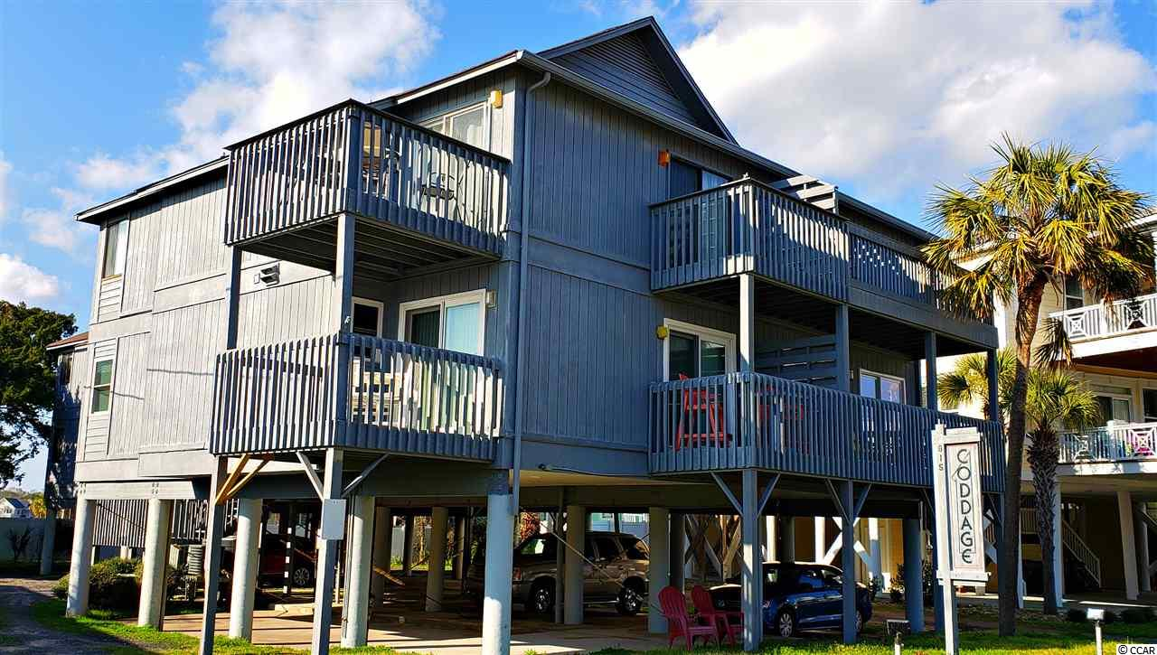 Are you looking for that smaller complex where it is quiet? This complex is just what you are looking for. This is a 2nd floor 2br/2ba unit located on Waccamaw Drive on the south side of the building. You have two balconies facing the ocean(one off the living room, and one off of the dining room area). Each balcony does have a view of the ocean though somewhat limited. You can still enjoy the sounds of the waves as they roll onto the beach; and the late afternoon ocean breezes as you relax on either balcony. This is a really good value, and very affordable. Call to view today.