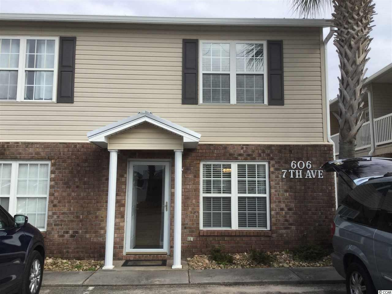This beautiful end unit townhouse located east of HWY 17 is within walking distance to the beach. With the recently replaced roof and fenced back yard, this can be an excellent second home or a great investment venture. Seabring is one of the rare friendly HOAs that truly is represented by the homeowners. Two bedrooms are conveniently located on the second floor with a full bath and rear baloney overlooking common area. The main level features living room, open concept kitchen with an island and a half bath. Located only minutes from Main Street (with its summer concerts), dining, shopping and of course the BEACH. Schedule your appointment to see this READY TO MOVE IN home.