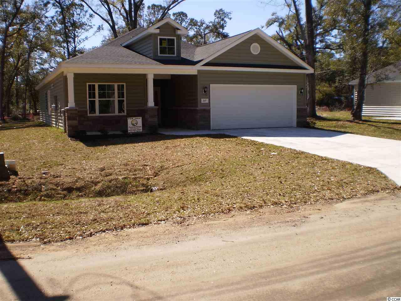 Brand new home in Pawley's Island. No HOA. Gourmet kitchen with granite counter tops, stainless steel appliances, upgraded cabinets with ceramic tile floors, hardwood flooring and carpet in the bedrooms. Ready to Move In!!!
