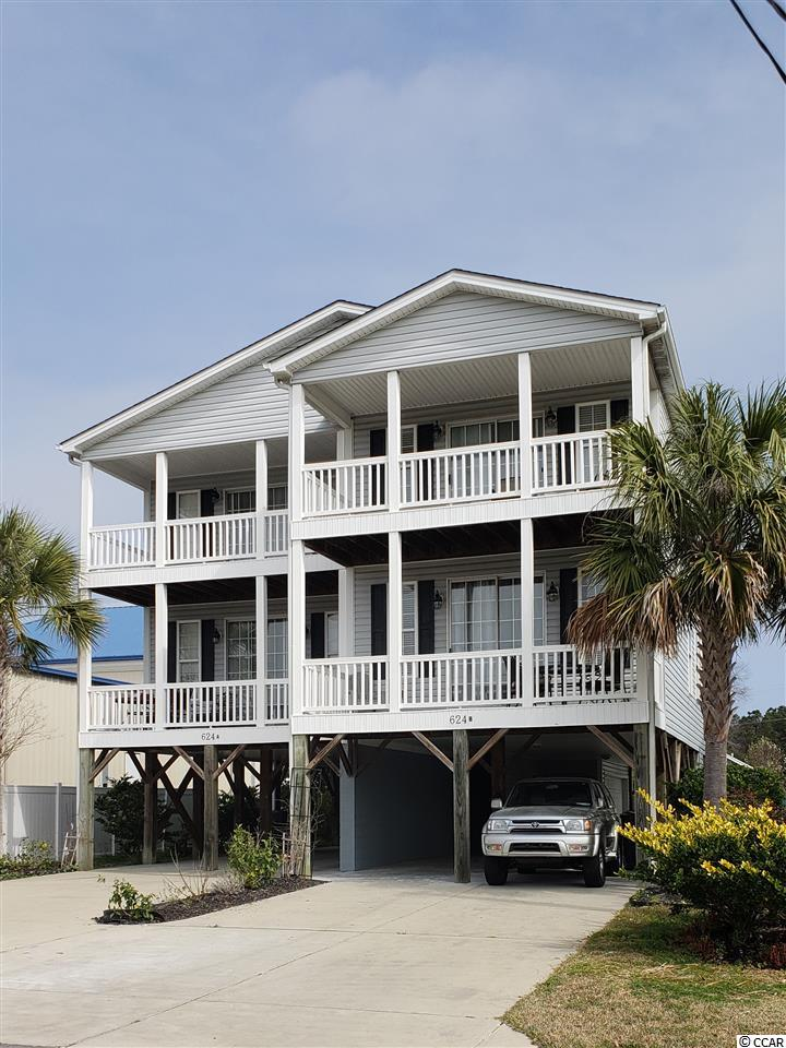 This raised beach duplex (Unit B) is a fully furnished 5 bedrooms, 4 baths property located in Garden City Beach. Enjoy a walk to the beach, people watching from one of two balconies or cool off in the outdoor pool. This duplex is located in a prime rental area so you have the value of ownership while the short term tenants make most of your payments plus there's no HOA fees. Great rental income! This semi-detached unit is an HPR. (Unit A is for sale MLS # 1913906.)