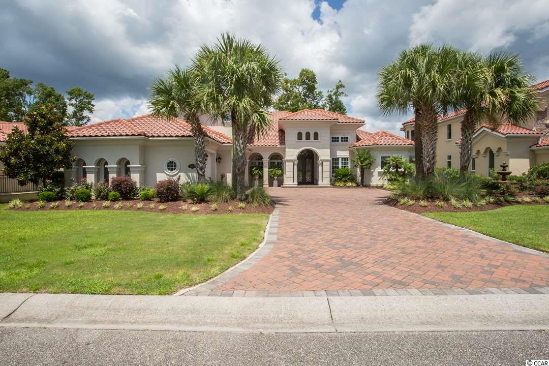 SIGNIFICANT PRICE IMPROVEMENT -PASS THROUGH THE MANNED GUARD HOUSE AND OVER THE WATERWAY TO VIEW THIS ELEGANT 4BR/4 BA LAKE FRONT HOME WITH MANY EXTRAS INCLUDING A WHOLE HOUSE GENERATOR LOCATED IN THE GRANDE DUNES -  MYRTLE BEACHES MOST PRESTIGIOUS GATED COMMUNITY WHICH FEATURES TWO GOLF COURSES ONE OF WHICH IS TRULY PRIVATE . RESIDENTS ENJOY MEMBERSHIP IN THE 25,000 SQUARE FOOT OCEAN CLUB WITH ITS PRIVATE OCEAN FRONT POOLS, POOLSIDE AND FORMAL DINING ROOMS AND SECOND FLOOR MEETING ROOMS.  THIS ELEGANT 4BR/4BA STEEL FRAMED HOME FEATURES 4100 SQ. FT OF LIVING AREA WITH OVER 5700 SQ. FT. UNDER ROOF WITH WHOLE HOUSE  AUTOMATIC GENERATOR.  FEATURES INCLUDE – FIRST FLOOR MASTER WING WITH HIS AND HERS WALK IN CLOSETS, WINE AND COFFEE BAR WITH WINE COOLER. THE ADJACENT MASTER BATH INCLUDES HIS AND HERS ITALIAN HAND CARVED VANITIES , JETTED WHIRLPOOL TUB AND UNIQUE WALK THROUGH SHOWER.  THE GOURMET KITCHEN FEATURES CUSTOM CABINETRY , HAND CRAFTED BACK SPLASH WITH GRANITE COUNTER TOPS AND A VENETIAN PLASTER CEILING. ALSO LOCATED ON THE FIRST FLOOR IS A GUEST SUITE WITH ENSUITE BATH, FORMAL LIVING AND DINING ROOM AND AN ADDITIONAL FULL BATH WITH OUTSIDE ACCESS. THE FAMILY ROOM IS AMAZING WITH ITS FIREPLACE AND BREATH TAKING 25FT. VAULTED CEILING .   THE ELEGANT STAIR CASE LEADS TO THE SECOND FLOOR WHICH INCLUDES TWO ADDITIONAL BEDROOMS WITH AMPLE CLOSETS AND A FULL BATH. ALSO LOCATED ON THE SECOND FLOOR IS A LARGE  HEATED AND COOLED STORAGE ROOM.    EVERY WHERE YOU LOOK YOU WILL SEE CUSTOM HAND CRAFTED DESIGNER TOUCHES WHICH MAKE THIS HOME A ONE OF A KIND SHOW PLACE.