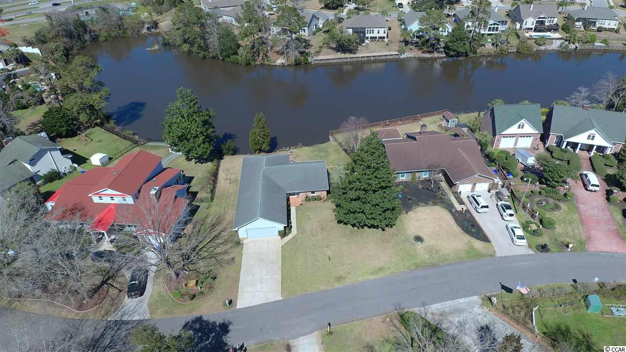 """This is a rare opportunity to have a lakefront home on Lake Dogwood in Surfside Beach """"The Family Beach"""".  Just six blocks to the ocean, a short golf cart ride through a  quiet neighborhood. Lakefront houses rarely are offered for sale in this neighborhood.  One-level living."""