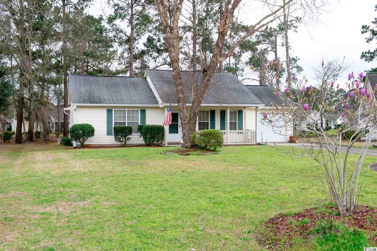 Private, serene and Oh What a View! Great lake view from this lovely 2 bedroom, 2 bath home in the popular 55+ community of Woodlake Village. You are sure to be impressed from the moment you drive up to this lovely home with a low country front porch, great curb appeal, lush landscaping on a large cul-de-sac lot overlooking the lake. Open floor plan with spacious living room with vaulted ceiling, attractive laminate wood floors and ceiling fan. Dining room with laminate wood floors leading to a large family or Carolina Room. Start your day in the bright and cheery, good sized kitchen with breakfast nook, vaulted ceiling, ceramic tile, lots of cabinets and counter space, window with lake view, solar tube bringing in natural light, ceiling fan and wonderful lake view. Or better yet, head to the pretty Carolina Room with windows galore, ceramic tile, ceiling fan and sliding door leading to the backyard patio. Sip your morning beverage while watching the ducks and enjoying the great view of the lake and nature at its best. This is sure to be one of your favorite spots to relax, enjoy the weather, read a good book or enjoy the views. This immaculate home features two masters. Master bedroom with laminate flooring, ceiling fan, walk-in closet and 2 windows overlooking the lake. Master bath with shower/tub and ceramic tile floor. Large guest bedroom with ceiling fan, laminate floors and guest bath with tile, window, walk-in shower and laundry area with newer washer and dryer that convey. A favorite spot is sure to be the patio where you can relax, enjoy the pretty lake view and nature at its best while grilling dinner and creating memories with family and friends. The charming front porch will be great for enjoying those evening breezes. Oversized 1 car garage with utility sink, floored storage in attic, termite bond. Newer HVAC (2016), newer high rise commodes in both baths and kitchen and master bath faucets (2018), newer garage door and sliding door, newer gutters (2015), newer washer (2016), newer irrigation pump (2013), master bedroom and bath painted in 2018, You will be surprised by the amount of space in this move-in ready home. Great value, location and view! This community with its low HOA fees offers a clubhouse, library, outdoor pool, tennis and shuffleboard courts and is conveniently located just minutes from the beach, hospital, shopping, marina, restaurants and the Murrells Inlet Marshwalk. Square footage is approximate and not guaranteed. Buyer is responsible for verification.
