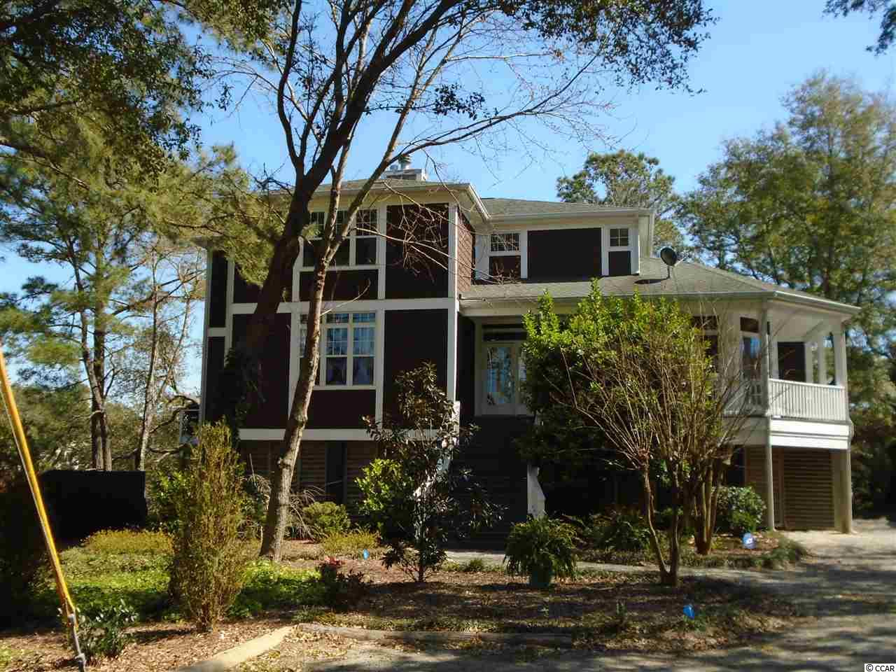 This Pawleys Island hidden marsh retreat is bordered by wetlands and lies beneath a canopy of majestic oaks, maples, pine and magnolia trees.  Sip ice tea on the screened porch or relax in a rocking chair as you take in the countless spirits of the birds, such as the blue herons, egrets, hummingbirds, cardinals and bluebirds just to name a few.  In keeping with its natural beauty the property has been artfully maintained by the green thumbs of a master gardener.  In the spring we welcome the blossoms of the weeping cherry, the hydrangeas, the magnolias, and the kaleidoscopes.  As the gardens and marshes blanket the property, no grass needs tending.  This original marsh arm stands alone, outside the confines of a neighborhood, while close enough to lend a cup of sugar.  For shell seekers, the beach is less than a mile away.