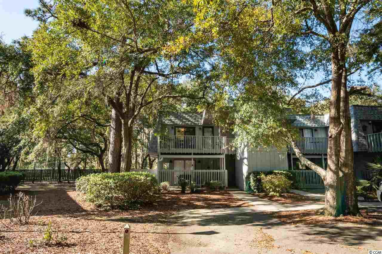 Salt Marsh Cove two bedroom one and one half bath condo under live oaks. This community enjoys a mature setting on the creek with community pool and marsh dock. Excellent building location with lots of natural light. Convenient to beaches, waterway, numerous golf courses and dining.