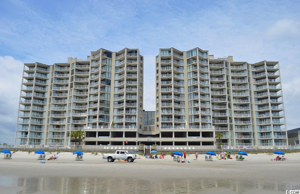 Seller will provide a generous painting allowance. One Ocean Place is a highly sought after condominium complex in Garden City Beach.   Enjoy oceanfront views from this 7th floor 3 bedroom, 3 bathroom unit.  Unit 704 is farther out than the units on either side so the views up and down the coastline are unobstructed.  Past renters give this condo 5 star reviews and enjoy it so much they book again for the following year.  Oceanfront master bedroom.  Glorious ocean views from the living room.  The 2nd and 3rd bedrooms each have their own bath.  Updates in 704 include: GE Monogram appliances, 2 ovens, an added pantry closet behind the wet bar which almost doubles your storage space in kitchen, can lighting.  Ceilings are SMOOTH!  One Ocean Place owner amenities include a private lounge room and fitness room.  Close to everything Murrells Inlet and Myrtle Beach have to offer including the beach, Garden City Pier, airport, hospitals, restaurants, shops, and golf courses galore.