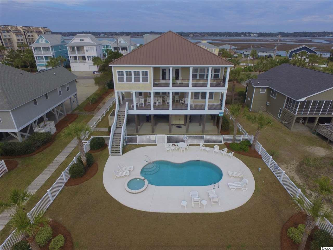 """Looking to channel your inner """"Sea Spirit?""""  Look no further as this beautiful beach home consists of 8-bedrooms and 8.5 bathrooms.  It sits on one of the deepest and most protected (by sand dunes) 75' wide lots in Garden City Beach.  It has hardwood floors in the living areas and granite counter tops & stainless steel appliances in the kitchen.  Amenities such as a private heated pool, hot tub, double oceanfront porches, two very large living areas (upstairs living area has a pool table and kitchenette) all make it a very good rental property.  You are just a short walk from the ship store and fishing charters at Marlin Quay Marina and wonderful meals at Gulf Stream Cafe.  Contact the listing agent, or your Realtor, for more details or to set up a private showing."""