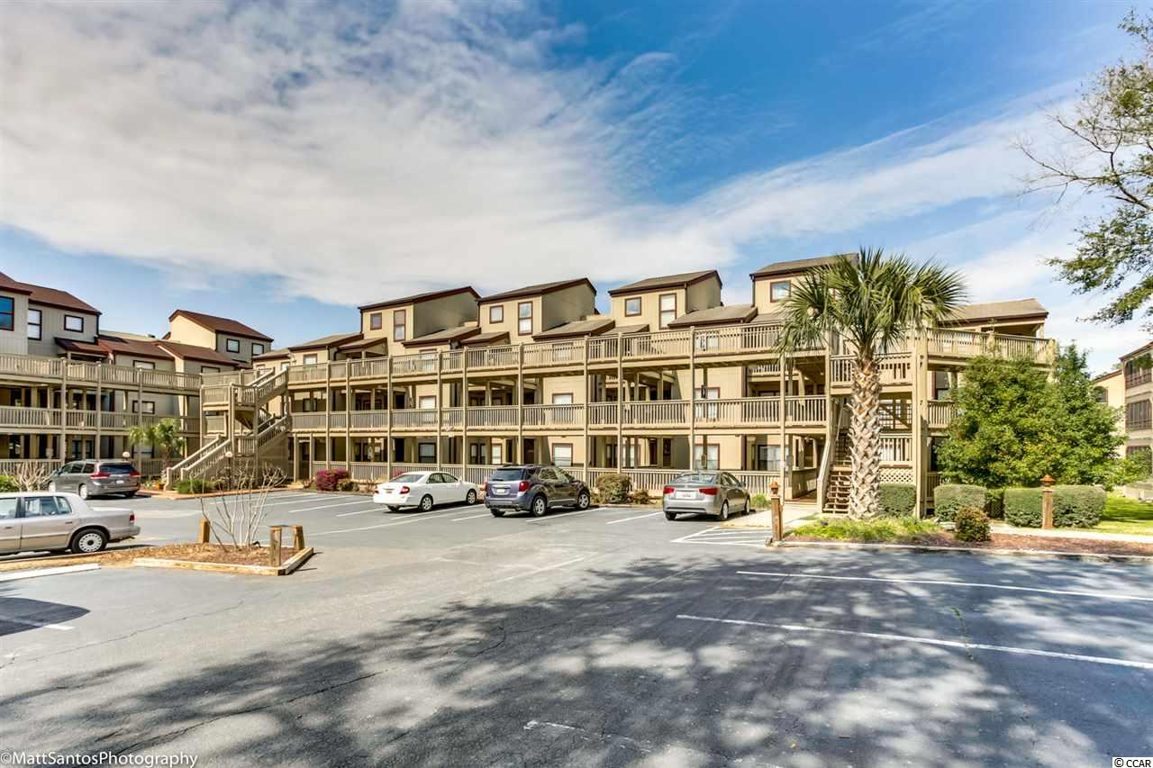 Beautiful, fully furnished and Immaculate End Unit in the very desirable Dunes Pointe in the Arcadian Section of Myrtle Beach with a wrap around screened porch with brand new outdoor composite wood floor with view of Dunes Lake & Golf Course and beautiful sunsets. Drive, Walk or Golf cart ride to the beach to your community Beach Cabana with FREE parking or enjoy your outdoor pool with hot tub, indoor pool with hot tub, tennis courts and clubhouse on property. HOA fee includes EVERYTHING except your Electric Bill. Turn Key deal. Buy today, move in tomorrow. Buy as a primary, secondary or investment property. One of the sofas is a sleeper sofa so you can comfortably sleep 7 people. Unit used solely as a vacation home for family, never rented. Everything you need right down to the flatware. Don't miss out on this one. Schedule your appointment today!All measurements and square footage are approximate and not guaranteed. Buyer is responsible for verification.
