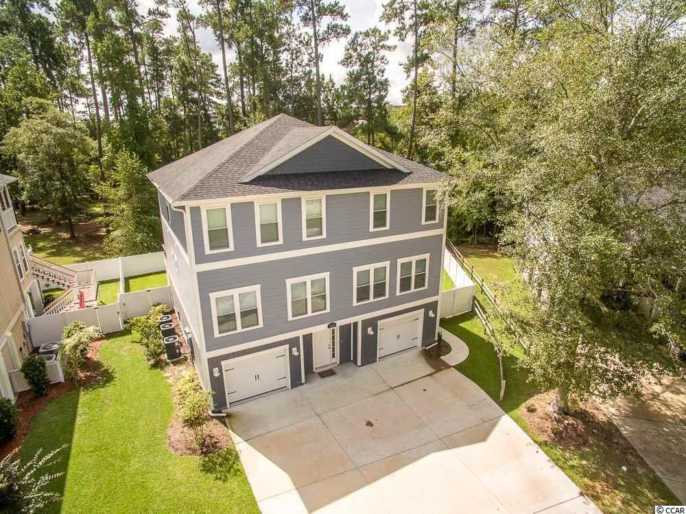 ntracoastal Waterway Gated Community! A quiet community off of Peachtree Road; this Home is a Contractor's dream. With 4,200 sq feet of heated living space, Two Master Suites, an a large bonus recreational room, 124 Kenzgar Drive is a must see! Built in 2015, this like new home boast a kitchen built for a chef and entertaining, is accompanied by a 12 feet long breakfast island and all stainless steel appliances, beautiful quartz granite, a one of a kind stainless steal farm house sink, and 42'' solid wood white cabinets. Enjoy views of the water from the large 39 feet deck, or take a stroll down by the water with the multiple look out decks just feet away and watch the boats go by, or put your boat in at the boat launch and landing, which sits adjacent to the property, with access to the Intracoastal waterway. The large bonus room on the bottom floor has all of the plumbing to install another kitchen or wet bar, with full four piece bathroom, this space could potentially double as a mother in law suite. Other features include, three HVAC units, two 80 Gallon hot water heaters, Hardie Plank siding, irrigation system for the lawn, and two attached single car garages. This property has never been lived in, create your memories today! Follow the link in the virtual tour for a great view of this amazing property!