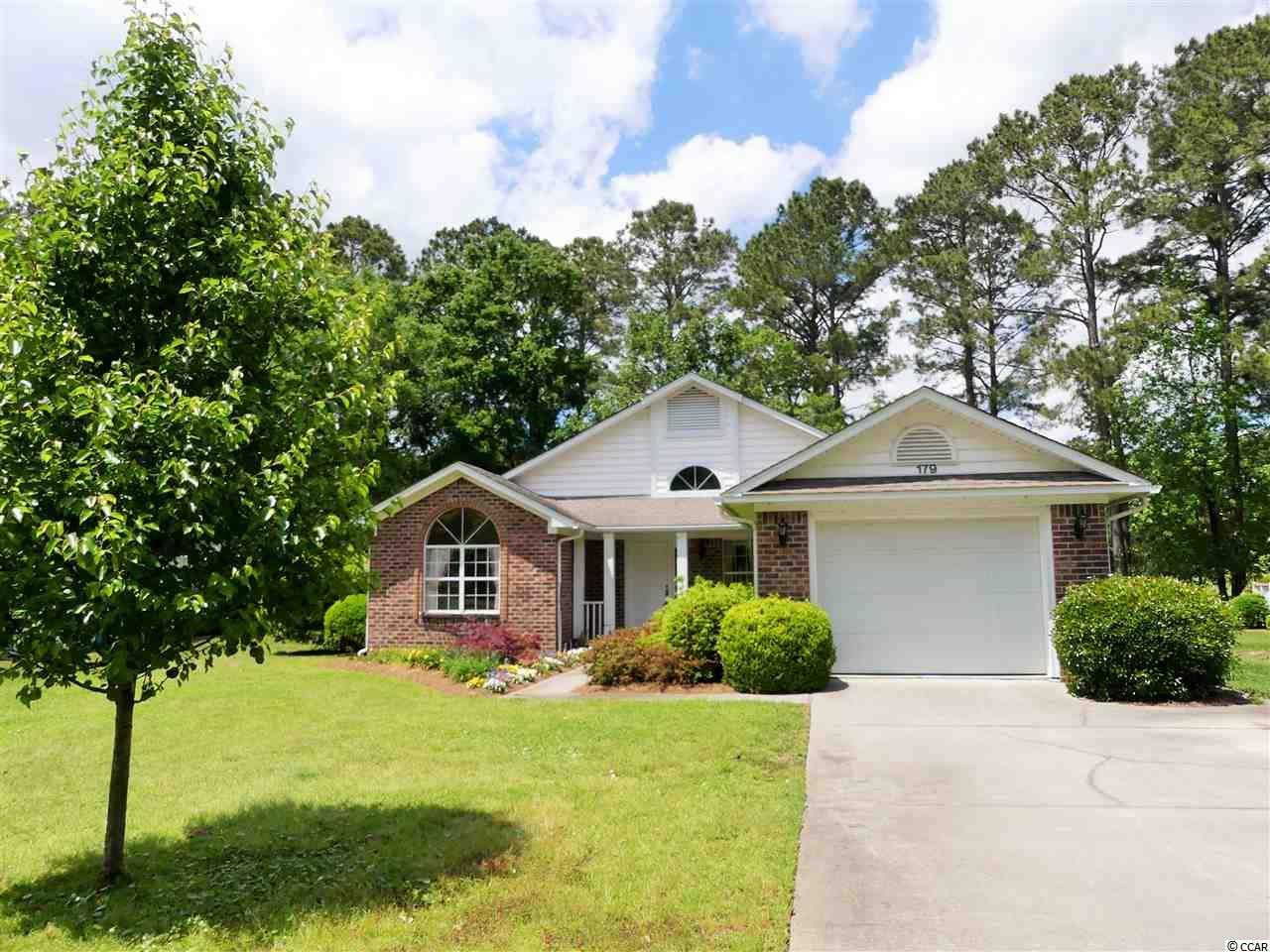 Immaculate home in the sought after River Club community of Pawleys Island, SC ! The all brick house at 179 Mackinley Circle features an open floor plan, 2 spacious bedrooms, an incredibly large sun-room area, an over-sized 1 car garage, a clean white kitchen with granite counters, and a rear porch area overlooking the golf course. The River Club is a gated community located less than 2 miles to the ocean and houses an 18 hole golf course, tennis courts, pool, a full club house, and private beach access through Litchfield by the Sea.