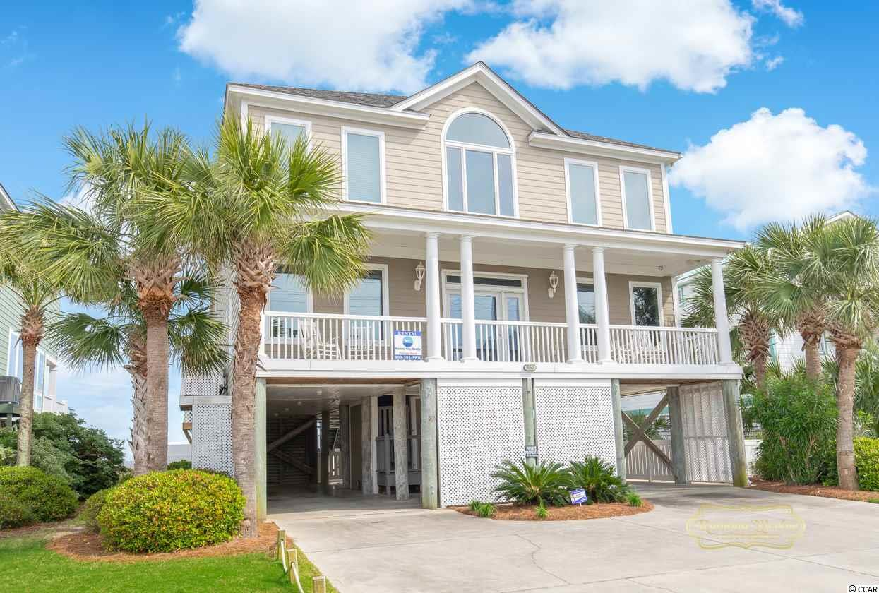 """This Breathtaking Beachfront Beauty in Garden City has it all. 7 bedrooms and 6 1/2 baths  allows you to have room for everyone. A perfect combination of quiet beauty and family fun. This property has an absolutely phenomenal rental history. The sooner you buy, the more income you will have. The house is loaded with all the whistles and bells you can think of, to included an elevator, gas fireplace,stainless steel appliances, granite counter-tops, 2 dishwashers, extra ice machine, wine cooler and an incredible custom 16 foot dining table  In addition to  all the beds and baths, there is a beach-side game room with extra beds  if an 8th bedroom in needed. The master suite encompasses the entire end of the 2nd floor and includes a sitting area, private oceanfront porch, Jacuzzi tub, walk in shower, vanity , TV and of course lots of closets. Off the living area , you will step into an enormous cover porch and enjoy the cool breeze on our warm Carolina days. Strolling down stairs, you have a heated L-Shaped pool, hot tub, outdoor shower, outdoor bar and pretty patio made with pavers. You will also appreciate the convenience of the  poolside bathroom and private walkway to the beach. This where you take full advantage of the """"art of ocean watching"""""""
