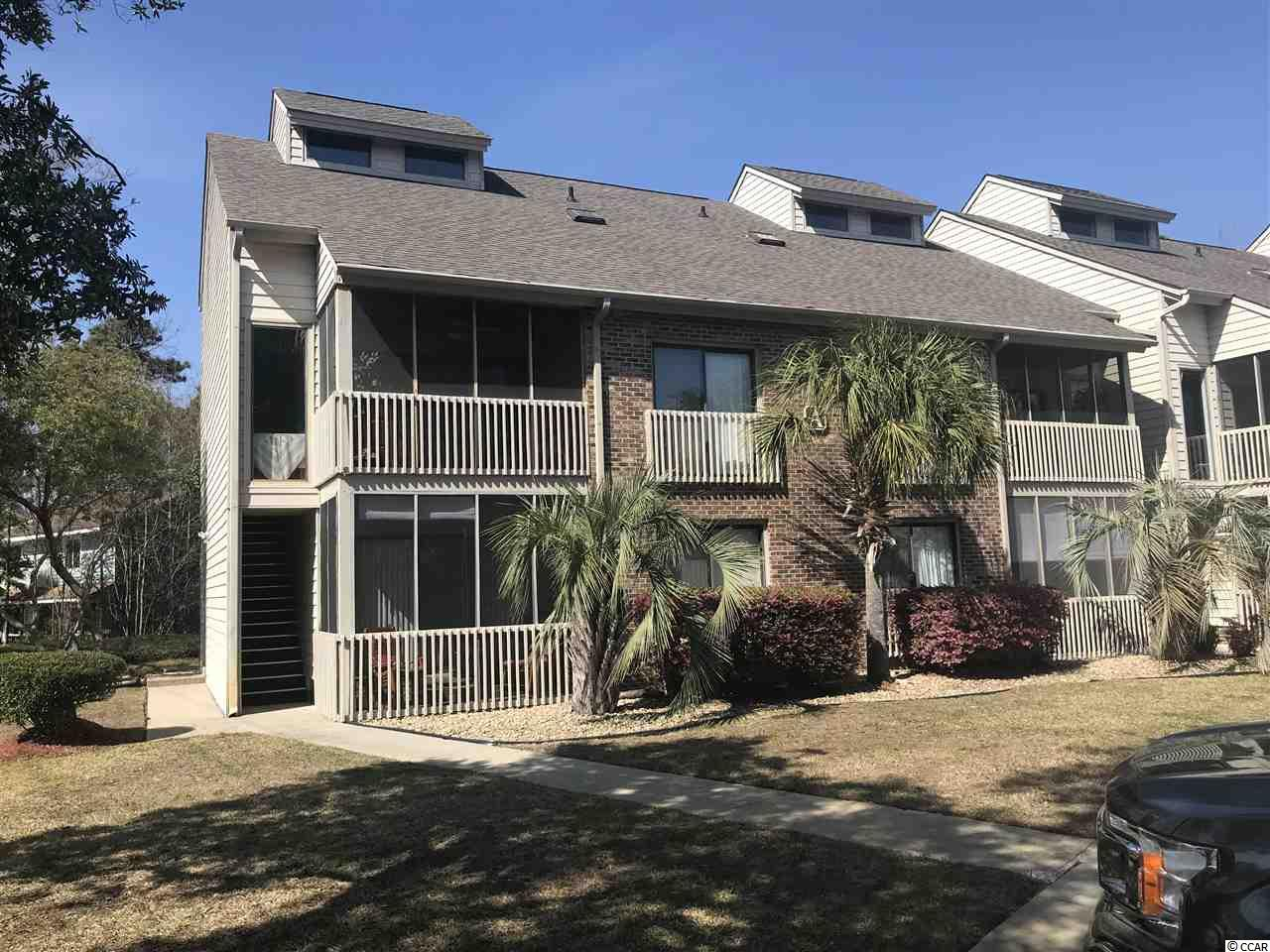 Well maintained beach condo in a great location in family-friendly Surfside Beach. Start your day on your private, screened porch with a view of beautiful live oaks or take a mile walk or drive your golf cart to the beach and enjoy a beautiful sunrise. During the day, relax by the outdoor pool and at the end of the day you can get glimpses of the setting sun from the small back patio. Shopping & dining only minutes away. This ground floor condo features a private side entrance unlike most of the units. Two bedrooms & 2 full baths with walk-in showers. Pergo flooring in the living/dining area & master bedroom. Laminate flooring in the 2nd bedroom plus tile flooring in the kitchen area & bathrooms. Kitchen features Corian countertop. Ceiling fans in Living Room & both Bedrooms. New roof installed in 2017 and a new HVAC system installed in July 2018. Square footage is approximate and not guaranteed. Buyer is responsible for verification. Owner allowed 1 pet up to 30 lbs.