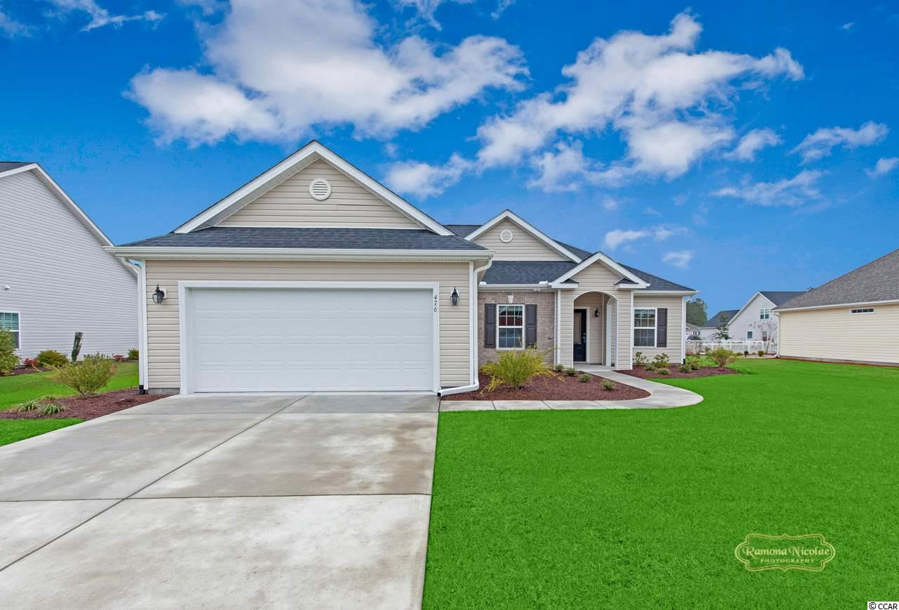 Photographs are of this Home. 'This Home is completed and Move-in-Ready and is located in the Beautiful Hillsborough Community, centrally located just off Highway 90 within minutes of Historic Conway, the River Walk and International Drive providing direct access to Myrtle Beach within minutes of Shopping and Entertainment Venues. This Bedford plan can be visited onsite as is Completed and MOVE-IN-READY!. Our Bedford Home is situated on an Estate Home Site with a Bonus Room, Four Foot Garage Extension, and a Large Covered Rear Porch with water view. This home also includes the following upgrades Beautiful Brick adjacent to the Front Entry Door with a Large Beveled Edge Rectangular Glass Lite & Brushed Nickel Barcelona Handle Set. FLOORING: Engineered Hardwood at Foyer; Great Room; Dining Room, Hall #1 to Bedrooms as well as the Kitchen and Breakfast Area. Wood Stairs with Wood Pickets to Bonus Room above. Carpet: at Master Bedroom; Bedroom #2 & #3 as well as Bonus Room above. Tile: Tile at Master Bath, Bath #2 and Laundry Room. Upgraded Designer Kitchen with Staggered Height Cabinets, under cabinet lights in Kitchen and Larger Crown Molding, as well as Pendant Lighting above Granite Countertop; Range, Oven/Microwave and Dishwasher are Stainless; Whole house faucet upgrade to Satin Nickel; Comfort Height toilets in Master Bath and Bath #2; Raised Vanity at Master Bath with a Bank Drawers at Vanity; Cultured Marble Riverstone Vanity Top; Optional Master Bath Layout includes oversized Tile Shower with a Corner Seat. Bath #2 has Cultured Marble Raised Height Vanity. Recessed lights at Family Room & Kitchen. Home includes Refrigerator, Washer/Dryer, blinds, screened in back porch and Whole House Gutters!!! Ask us about the Benefits of an Energy Plus Home. Amenities include lighted Fountains at the Community Entrance, a lovely tree line entry leading to the Club House and Swimming Pool.
