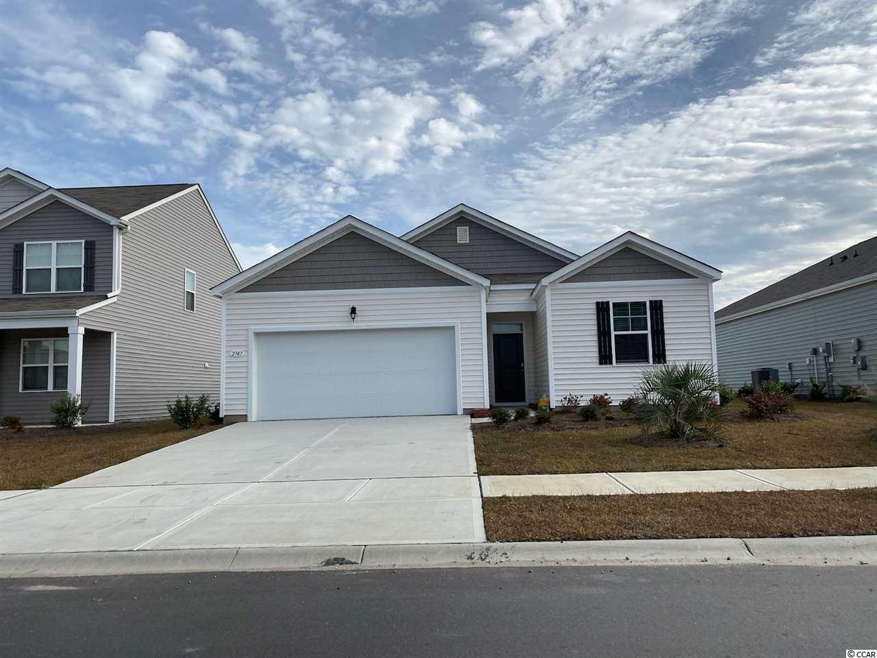This adorable open-concept 1-level SMART HOME will be ready this JUNE!!! Enjoy a large family room, private owner's suite, rear covered porch and 2-car garage. Kitchen features cream cabinets, granite countertops, stainless steel appliances including refrigerator, and breakfast bar with pendant lights. Home has solid surface flooring (resilient hardwood-look vinyl) throughout main living areas, bathrooms and laundry room. Washer, dryer and garage door opener included! Our home owners will enjoy a gracious pool, hot tub, air conditioned pickle ball court/meeting space, walking trails and a short golf cart ride to the beach. Live like you're on vacation! Photos of home are of a model home of same floor plan in another community and are for presentation only.