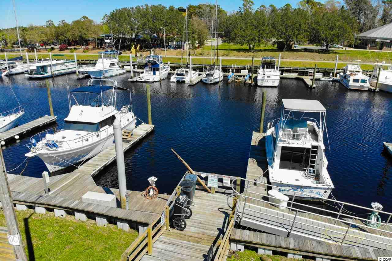 40' Boat Slip available for sale at Dock Holiday's Marina located in North Myrtle Beach on the ICW. Dock Holiday Marina is located off of Hwy 17 just behind Boardwalk Billy's restaurant. You are also close to Coastal North Town Center Shopping Plaza, Carrabba's, Mellow Mushroom and coming soon Rioz. Electricity is available to the slip. There is a bath house and laundry at the Marina office. Cruise on in the heart of North Myrtle Beach and make yourself feel at home in Dock Holiday Marina!