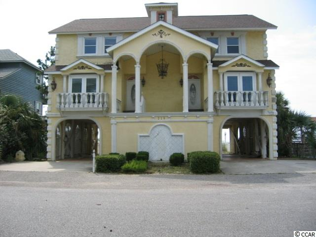 A Diamond in the Rough! Price is reduced on this huge 7 BR, 5.5 bath OCEANFRONT beauty. She has been neglected and needs some TLC to bring her back to her glory. Many opportunities for this property as it has 2 separate kitchens and living areas and is in the commercial zoning of Surfside Beach.The views are incredible and the location is so convenient. Walking distance to restaurants, entertainment, piers, shopping. Here's your opportunity to buy oceanfront at a great price and renovate to your own taste! Don't wait, contact your agent for a showing today!