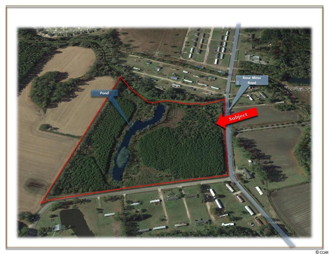 OFFERED FOR SALE is this 20.50 +/- Acre Tract  located at the corner of Rose Moss Road and  D Street with a half acre +/- pond that extends to both sides of property. Zoned FA suitable for large estate, single family dwellings or manufactured/mobile homes.   GENERAL SITE INFORMATION: Approximately 20.50 /- Acres Approximately 790 Feet of Frontage on Ross Moss Drive   NEIGHBORHOOD: Conway is family-oriented small town with a nice historic district. In close proximity to Conway Medical Hospital, Coastal Carolina University, Webster University, Entertainment, Restaurants, Retail Shops, and a variety of local events. Approximately 1 Mile to Highway 501 From Rose Moss Road Approximately 5 Miles to Highway  22 Approximately 10 Miles to Aynor, SC. Approximately 12 Miles to Conway Medical Center  ZONING:  Forest Agricultural District (FA), County of Horry, SC.