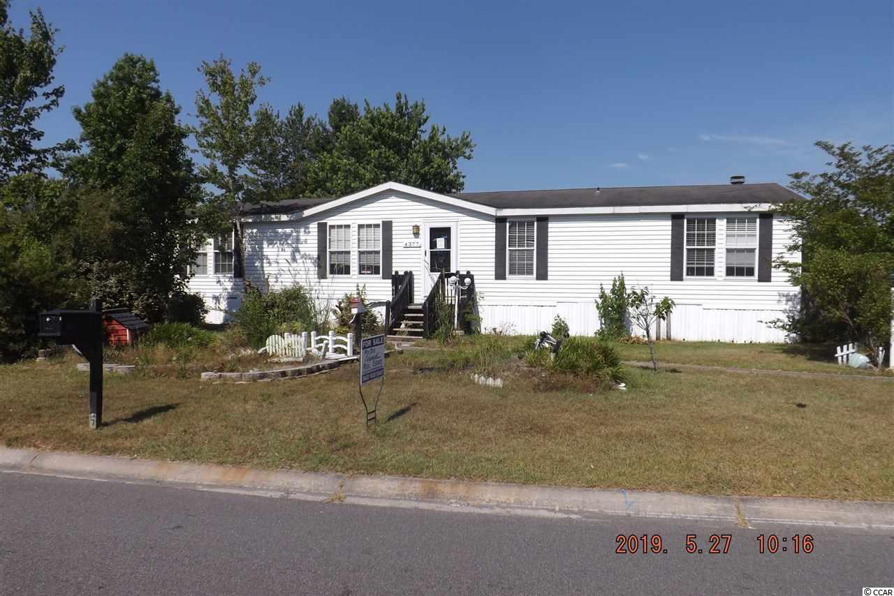 Very easy access to North Myrtle Beach. Three bedroom, two bath home, large family room w/fireplace, a formal dining room, and master bedroom suite. NO HOA fees!