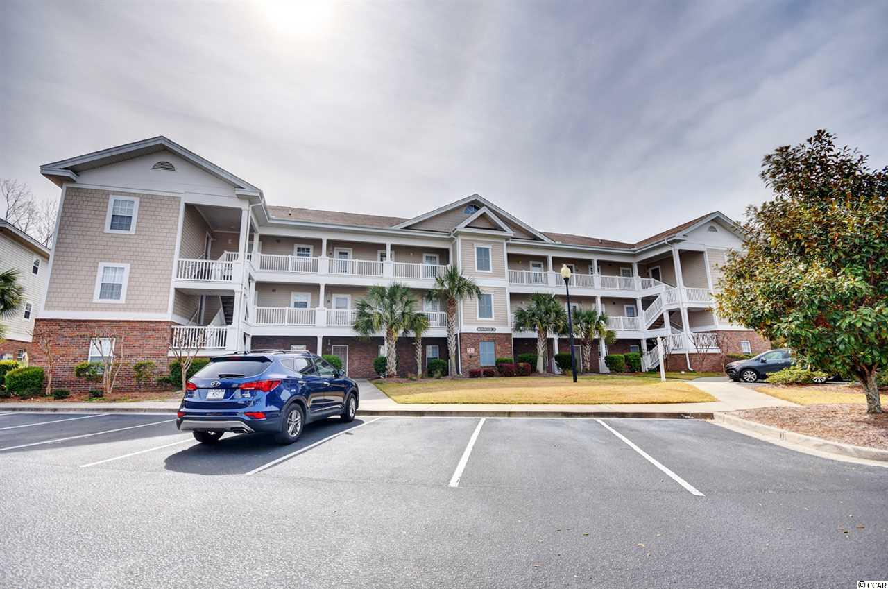 This end unit boasting tons of natural lighting located in the PRESTIGIOUS IRONWOOD development of Barefoot Resort has everything from Golf, Beach, Waterway, Marina, Amenities, and LOCATION!!! You will enjoy peaceful views from the balcony overlooking the Greg Norman Golf Course and Intracoastal Waterway in the distance. The trees and shrubs provide privacy for you to sit back and unwind taking in the scenery from your balcony. You have plenty of room to relax in this gorgeous three bedrooms with two full baths condo that features new vinyl plank flooring. The living and dining areas provide an open space for entertaining your family and guests. The kitchen is fully equipped with all the major appliances and lots of cabinet and countertop space. The spacious bedrooms are arranged on a split floor plan for privacy, and both bathrooms feature a single vanity with a shower/tub combination. The condo itself is Amazing, but you will Fall in Love with all the AMENITIES that come along with it!!! Ironwood has a pool and tennis court within the community just steps from this unit. You also have access to an Oceanfront Cabana, Parking in Windy Hill Beach, and the LARGEST Pool on the Grand Strand located next to the Intracoastal Waterway. This condo even comes with a transferable golf membership. This is a PRIME Location situated right in between North Myrtle Beach and Myrtle Beach with shopping, dining, the beach, and entertainment just minutes away!!! Make this your home away from home, your permanent home, or a great investment! Call today to make your Appointment to view this Spectacular Unit!