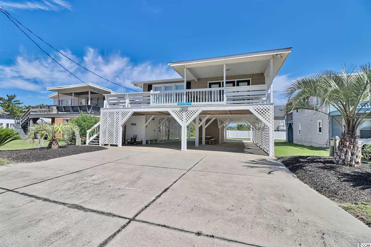 Just across the street from the Atlantic Ocean! Direct beach access is just steps away to the sandy beach!  This second row beach beauty offers a lot of upgrades and is beautifully furnished & ready for new owners to enjoy. The pilings, steps and porch were just painted. The owner sheetrocked the entire house, including the ceilings, installed bamboo flooring in Living Room, two of the bedrooms and hallway. Two other bedrooms had new carpet installed. Ceramic tile in the Kitchen and baths. The large Kitchen offers plenty of natural light and has BRAND NEW STAINLESS STEEL APPLIANCES that were replaced 7/11/2019. The beautiful Granite Counter-tops compliment the beautiful refaced cabinets and offers an abundance of storage. The front bathroom was remodeled complete with new tub/shower, vanity, touch free toilet. Both bathrooms have Granite Counter-tops. New light fixtures, ceiling fans and refrigerator were also installed. Vinyl shake siding was  installed on the exterior. The large Living Room adjoins the covered deck portion leaving the other side available for sun while enjoying the ocean view. There is also an outdoor shower as well as a storage/laundry on the ground level, complete with a brand new washer and dryer. The public boat ramp is just a few blocks away. The large backyard has enough room for a pool. This ideal beach house is convenient to main highways to get you anywhere around the Grand Strand, fishing, golfing, shopping, dining and entertainment. The owner has used this as a second home only. Fantastic rental potential based on location and condition! Put this one on your list to see!
