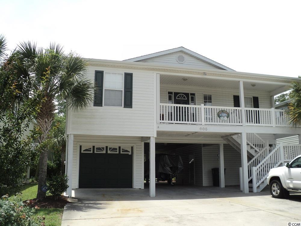 Welcome home.  Don't miss out on this well maintained 4 BR/3 BA raised beach house in North Myrtle Beach/Cherry Grove.  This amazing home is very spacious inside. Many great features and upgrades such as hardwood floors throughout, tile floors in kitchen, flat screen TVs in each room, sizable open living room,  FURNITURE INCLUDED, NEW HOT WATER HEATER, NEW WASHER AND DRYER, NEW HVAC UNIT (2017) NEW STAINLESS STEEL REFRIGERATOR, DISHWASHER, GAS STOVE WITH NEW PROPANE SYSTEM NEW PAINT AND LANDSCAPING ROCKS AND DRAINAGE SYSTEM,NEW OUTSIDE CEILING FANS AND LIGHTS,  large outside deck that can be accessed from the living room and the master bedroom, outside sprinkler system, outside shower, extra room with ac unit. The golf cart garage is a plus and just a short ride to the beach. If you are looking for a great location this is it!  Call today to view this beautiful home.