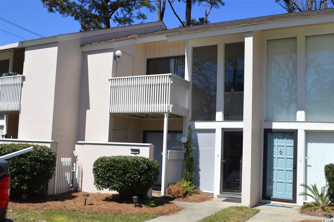 What a location!  Drive your own golf cart to the beach from this spacious 2 bedroom 2.5 bath unique townhouse style condo in the heart of Tilghman Estates. Unit has been freshly painted and has new kitchen floor.  There are lots of storage and built-ins.  Heat pump was replaced in 2011.  Subdivision features community pool and is well maintained.