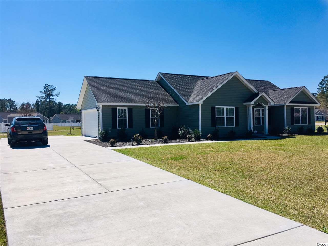 Private Gated River-Access Community offering a private boat ramp into the Great Pee Dee River. A new home sitting on a large lot with a boat and RV friendly POA. Move in ready with no punch list items. Close to several zip codes and two county seats. Country living outside the hustle and bustle of traffic with gated protection. The Augustus II Plan has a split floor plan. Vaulted ceiling in the living room and an open dining space with lots of natural light. The Master Bedroom has a large Master Bath with a walk-in closet. The Master Bedroom also has a tray ceiling with a ceiling fan. There are many extra closets sharing an abundance of storage space to include a floored attic above the 2 car garage. Upgraded Shaw Duratru vinyl flooring throughout the home. No Carpet! An extra breakfast eating area nook facing sunrise. The kitchen has a pantry and the laundry room is close by. The screen porch overlooks the back yard and also greets the sunrise. An open air patio shares the back yard for outdoor sunning and grilling. This is a quality built home by Beverly Homes. Easy to see and easy to understand the value in the home and the subdivision. This is a perfect starter home, second home or retirement home. FURNISHED! The Dining Room table, the sideboard, and the piano do not convey.