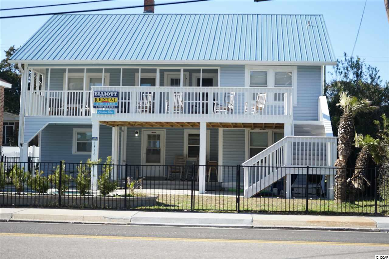 WOW!! This classic beach home is located in the Crescent Beach section of North Myrtle Beach, close to restaurants, golfing, shopping and shows.  This home was previously a duplex with 4BR/3BA downstairs and 4BR/2BA upstairs. The current owner has changed this and tore out a wall and made it one unit with 3BR/3BA downstairs with a game room and 4BR/2BA upstairs.  There are 2 full kitchens and living areas.  The owner has put in a pool with landscaping and fencing.   Great potential for rental income from two units  or one.  Walk across the street and you're at the beach. There is a porch downstairs and the upstairs has 2 spacious porches with an ocean view. There is plenty of parking for the entire family. This property is sold completely furnished.  Call your agent today to check out this great home!!  New metal roof put on 8/2015.  Square footage is approximate and not guaranteed.  Buyer is responsible for verification.