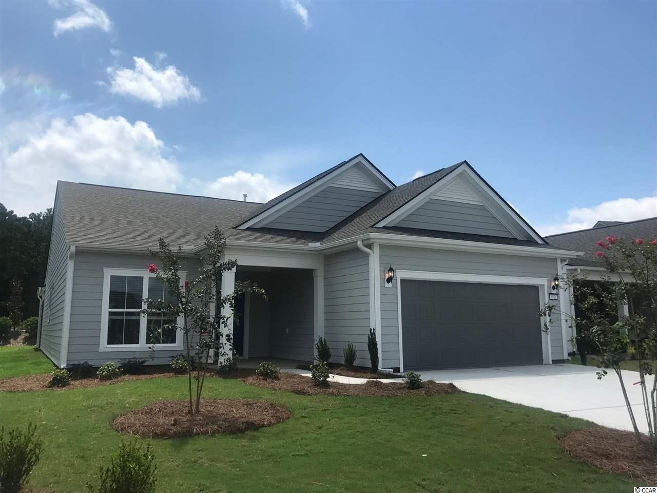 Martin Ray Floorplan with 3-bedroom/2-Bath , Library, Screened Lanai with Cascading Glass Slider doors, Fully Tiled Huge Walk-in Master Shower, Walk-in Master Closet. Walk-up Attic Storage over garage, Natural gas community, Tankless Water Heater and 2-car garage.