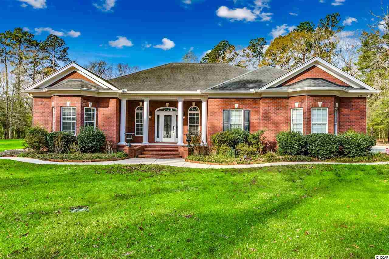 This custom all brick home has all of the bells and whistles and is sitting on 5.98 AC that is very secluded! No HOA!  Beautiful 3BR,2 1/2 BA home with a Master suite that is huge has crown molding, tray ceiling, marble shower, whirlpool tub and more! Kitchen has granite counter tops,  pantry, wall oven, warming tray and breakfast nook. Formal living room, formal dining, study/office, Carolina room and family room with fireplace! Beautiful tile flooring throughout this home, carpet in the bed rooms, and laminate wood in family room and study/office! Property also includes a detached 1200 sqft. all brick building with a full bath! Plenty of room for all of your toys and room to expand! This home is a must see, one of a kind! You are only 2 miles from International Drive and 5 miles from Downtown Conway! Prime location!