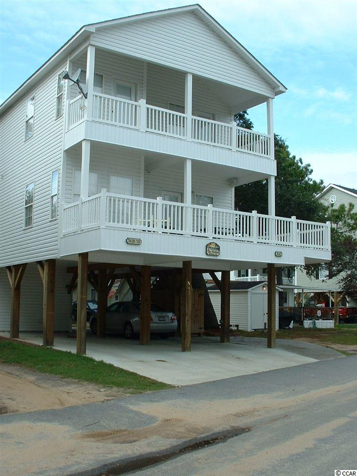 Tastefully decorated, and completely furnished, raised beach house located within the prestigious and highly sought after Ocean Lakes Campground, named 2017 Best Mega Park of the Year!! Gorgeous tree shades this home with 5 bedrooms & 3 full baths/Master BR on 1st floor.  Large eat-in kitchen with breakfast bar and pantry.  White cabinets, smooth top stove, stainless refrigerator with ice/water in door, dishwasher and built-in microwave.  Plenty of counter space and lots of light throughout this home.  All floors on first level are tile except MBR.  All bedrooms are carpeted and second floor BR's have vaulted ceilings and fans.  Lots of windows in this home-all vinyl tilt with wide slat blinds.  All bedrooms have wall-mounted flat screen TV's, and various bedroom sets.  MBR has a king, and the others have full beds with one BR having bunk beds that sleep 6!  LR has two sitting areas, leather couch & matching recliner & flat screen TV.  Kitchen has table that seats 8.  Two of the second floor bedrooms have door access to the front deck.  All three baths have tub/showers and one of the second floor baths has a stackable washer/dryer.    Large front deck with vinyl railings and wood flooring.  All outside furniture and picnic table to remain.  Outdoor shower and attached storage.  Plenty of under-house parking.  Home is in like-new condition!  There are no HOA fees however there is an annual lease which covers your basic cable TV, garbage removal, security and access to all pools, water-park and all amenities that Ocean Lakes has to offer. Don't miss this opportunity to own a home along a pristine part of the beach. Easy golf cart access to shopping, restaurants, activities, and so much more.   Ocean Lakes is a 310 acre ocean front complex with 24 hour security, nearly a mile of oceanfront, Outdoor Pool, Sandy Harbor Water Park, Sandy Mart, Meet n' Eat. Come play Basketball, Shuffle Board, Horse Shoes, enjoy their award-winning Recreation program. The gated campground 