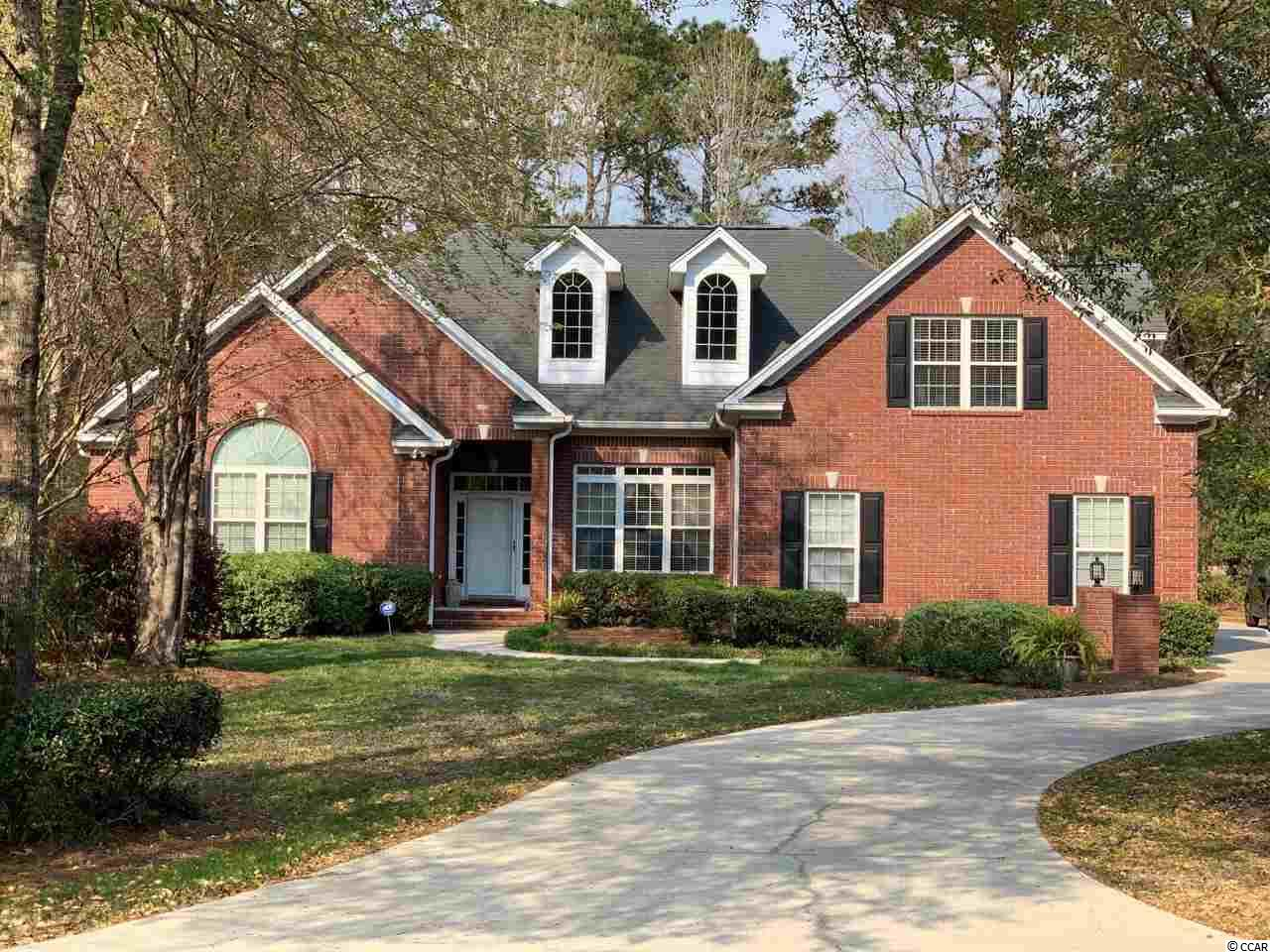 Unbelievable home at an unbelievable price! This elegant all brick home has an abundance of space for living in a prime location just minutes from the ever popular Marshwalk. This Beautiful Custom Home is located in the Estate Section of Indigo Creek Plantation. It comes with 5 spacious bedrooms and 3 full baths, a formal living room, a spacious bonus room, utility room, an office and a massive playroom!  The upstairs bonus room/5th bedroom can also be used as a perfect mother-in-law suite. The complete home with tons of space for a growing family! Enjoy the sweet sounds of southern living all in the comforts of your screened in porch and a beautiful view of the 9th-hole fairway. Welcome home...