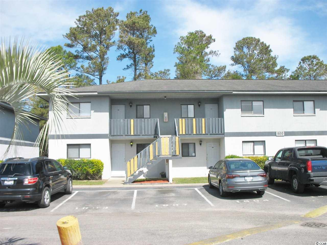 Cute Ground Floor, 2 Bedroom, 2 Bath Open concept Condo with Screened porch and community pool in Surfside Beach! Living room and bedrooms have nice/ high end ceiling fans with lights. Tile and Carpet flooring. New Refrigerator and Microwave installed in 2018. Master Bedroom has quiet view, walk-in closet and Master Bath with Low Threshold Shower. This condo in Tradewinds I is conveniently located on west side of Business Hwy 17 close to shopping, restaurants and the beach. Would be a great Primary home, 2nd Home or Rental Investment property. Don't miss it... these go fast!