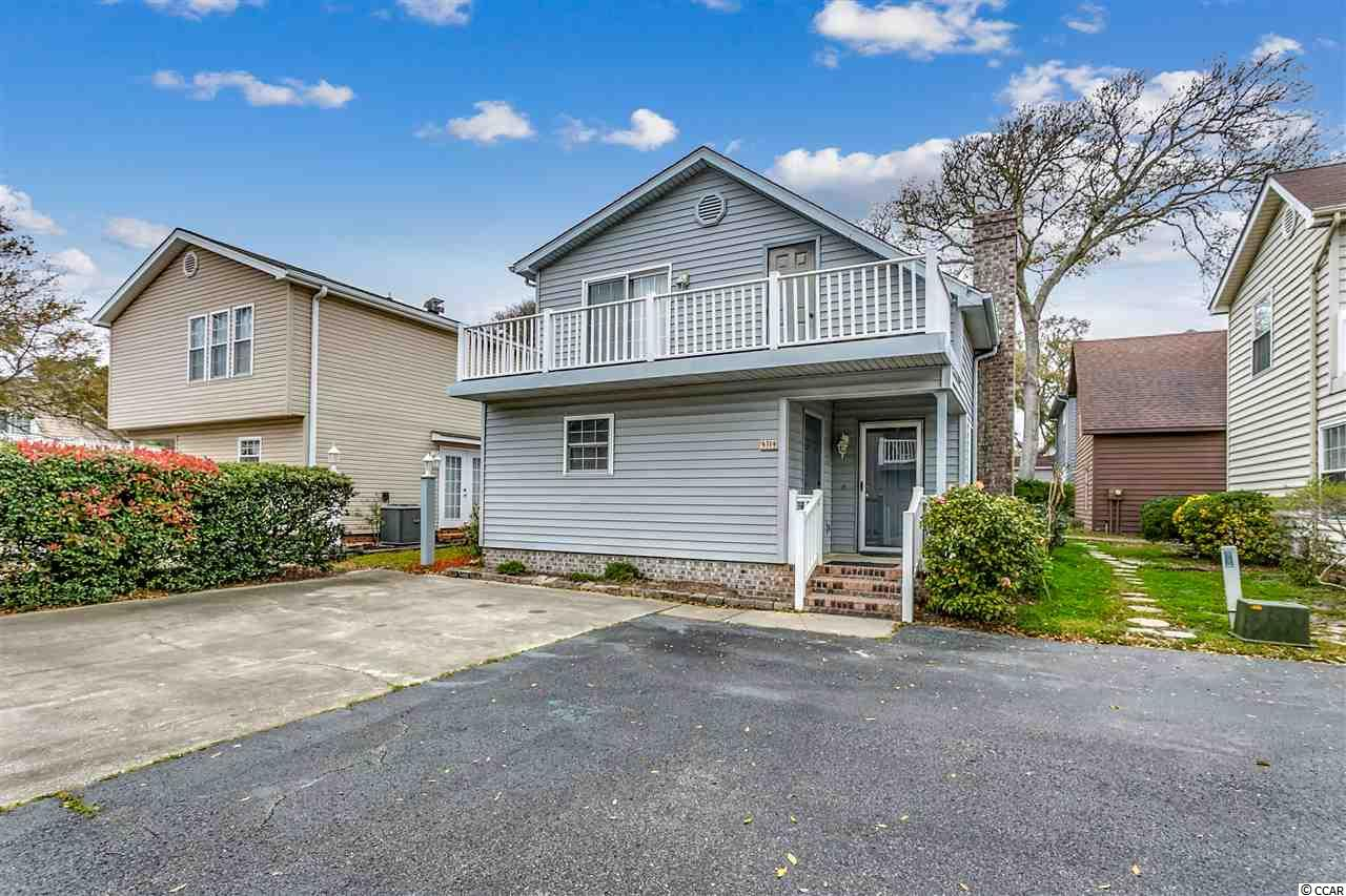 Come check out this very well maintained, 3 bedroom patio style home in the heart of the Windy Hill section of NMB. The spacious layout is located just a block from the beach and just a few steps from the community pool. The low HOA fees cover all the landscaping, pool access and common areas. The floorplan consist of an open living area with fireplace and a kitchen/dining room combo, first floor master suite with spacious bath. Upstairs has 2 very large bedrooms and a full bath with ample storage and balcony. Make this one a must see on your list.