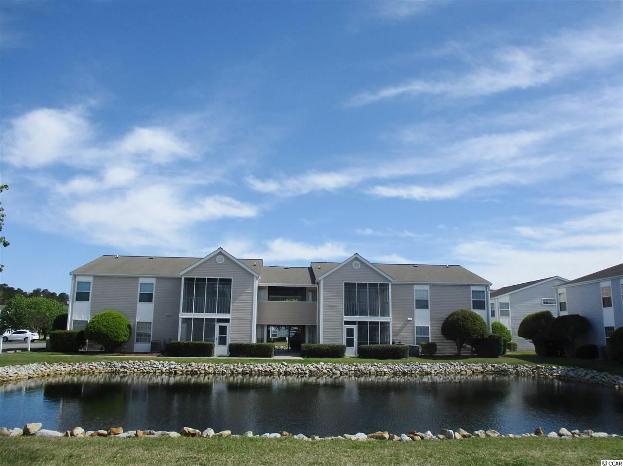 Wonderful well maintained desirable community close to the beach! South Bay lakes is in a prime location in Surfside Beach, surrounded by beautiful lakes and ponds! This is a well maintained second floor condominium! Light and bright with an open floor plan! Spacious kitchen, dining area, and living room open up to a covered patio that overlooks a scenic water view! Two large bedrooms, each with their own bathroom with newer vanities! HVAC replaced in 2012. This is a great opportunity to get your place, at the beach, whether a primary residence, second home, or long term rental! Spend your summer at the gorgeous community pool, that overlooks,a huge lake or just a short drive straight into the popular Surside Beach area, with pier, amazing beaches and great restaurants! Also just a short drive to the mall, airport and the popular Murrells Inlet Marshwalk, which has more shopping and dining right on Creek Inlet!