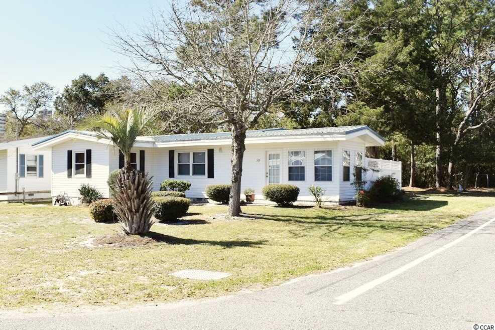 CUTE AS A BUTTON!!! Corner Lot, No HOA's, and an approximately 4 BLOCKS from the OCEAN!!! This adorable beach house comes FULLY FURNISHED and with a Carolina Room!!! Roof was replaced in 2017 and HVAC is approximately 9 years old. You can drive a golf cart to the beach within minutes. Just minutes away from all the shops, entertainment, restaurants, and golf North Myrtle Beach, SC has to offer. Schedule your showing today! Buyer is responsible for all measurement verification's.
