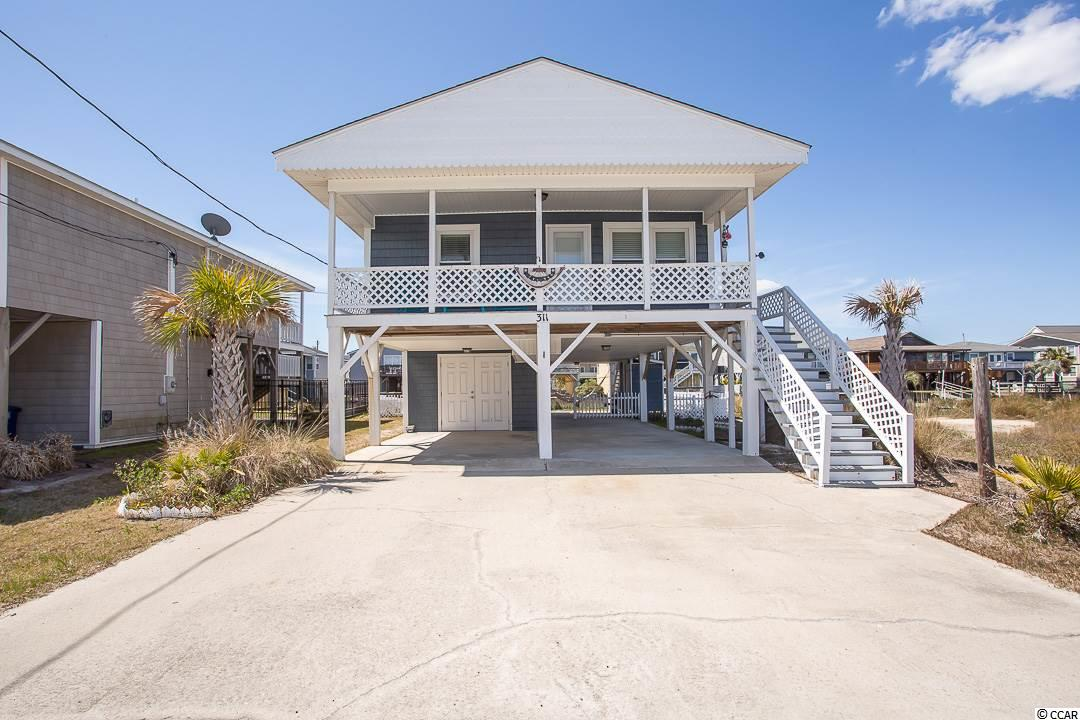 CHERRY GROVE CHANNEL HOME - 3 BEDROOM/2 BATH COTTAGE THAT OFFERS LOTS OF LIGHT, ACCESS TO THE CHANNEL AND LOTS OF UPDATED FEATURES. IN 2012 - NEW SIDING, NEW ROOM, NEW WINDOWS, NEW WATER PIPING, NEW DOORS. IN 2017 - NEW FLOORING, NEW TOILETS. IN 2015 - NEW FENCE. SIT ON YOUR DECK AND ENJOY THE SUNSET OVER THE CHANNEL - OR TAKE JUST A SHORT WALK TO THE BEACH!