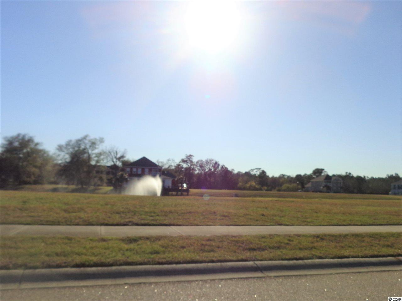 """One of the largest lots overlooking beautiful water feature in the Awesome """"Charleston style"""" community. Only a short stroll from the amenities center with beautiful pool overlooking marsh with view toward Cherry Grove beach area. Fun play area  and several lake areas with lovely  gavebos for leisure walks.  Very short drive to fine dining, golf, shopping and Of Course, beautiful beaches on the Atlantic Ocean!  Perfect place for your new home!!!"""