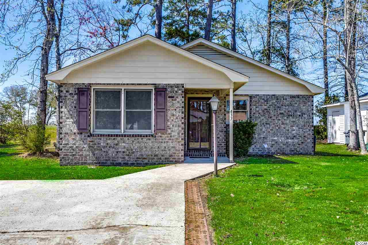 All brick 2 bedroom, 2 bath home tucked away in the quiet Golden Estate neighborhood in Little River. Vaulted ceiling in the living room along with 3 new vinyl windows and a skylight in the kitchen provide for an open and sun-filled floor plan. All kitchen appliances convey. Hot water heated replaced in Dec 2018. New roof was installed in 2010. Entire interior has just been painted a nice neutral color and the carpets have just been professionally cleaned. There are ceiling fans in the living room and both bedrooms. Master bedroom has a large walk-in closet and glass slider door to the back patio(15'x7'). The foyer, kitchen, bathrooms and laundry room have tile floors. The washer and dryer in laundry room convey. Relax on the newly re-screened porch (12'x7') and catch a glimpse of the pond in the back. Off-street parking for 2 cars (side-by-side) in the driveway. Attached storage room on right side of house. Come see this well-maintained property that is just minutes away from Little River restaurants and North Myrtle Beach's restaurants, entertainment, shopping and, of course, the Atlantic Ocean.