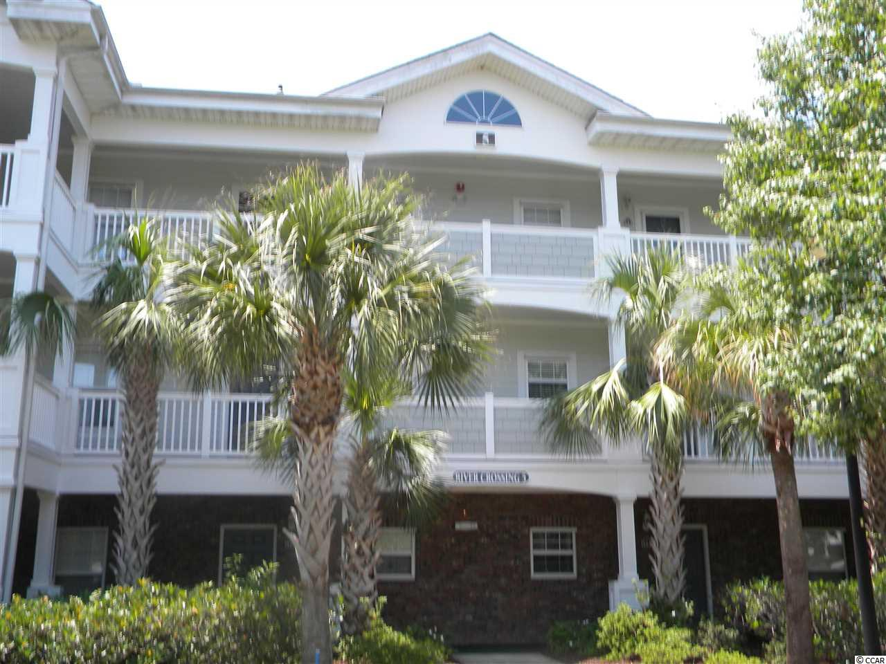 Fully furnished two bedroom, two bath Golf Villa in Barefoot Resort's Rivers Crossing community. This is an end unit located on the third floor with cathedral ceilings, lots of natural light and a open floorplan. Barefoot Resorts has great amenities including a private and oceanfront beach cabana and a seasonal shuttle service.