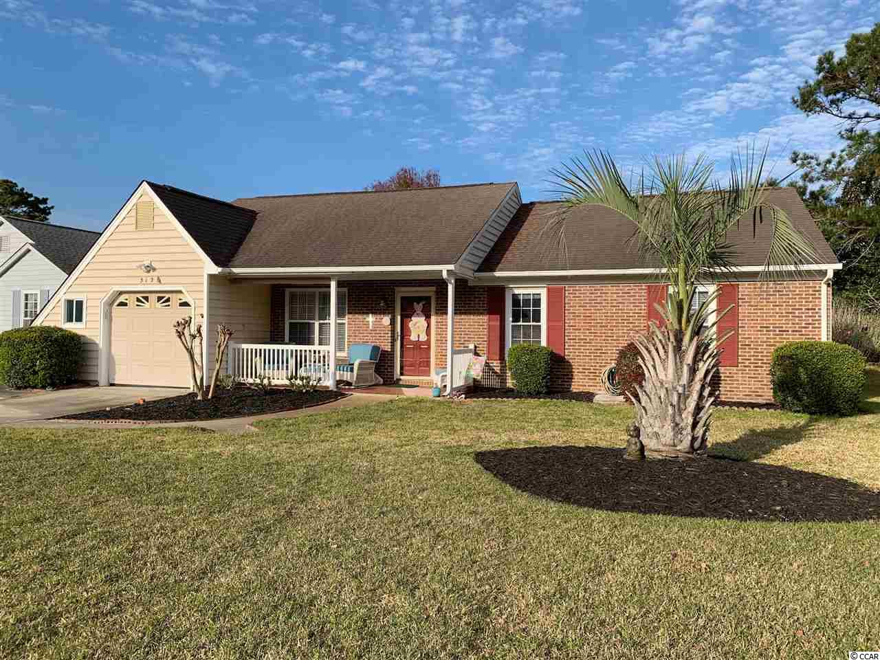 Ready to move in 3br 2bath home with 1 1/2 car garage with double driveway and beautiful Carolina room. Enjoy your southern evenings from your front porch or back patio. Furnishings and window coverings convey. Plenty of storage with 2 attics and workshop area in the garage. Master has his and her closets. 2 Linen closets. Located in Woodlake Village 55+community. Games, Tennis, Pickle-ball, swimming, shuffle board, dinners, dances, cards, bowling and much more! Golf Cart to the beach, shopping, groci store and more. Enjoy the Marsh walk, Brookgreen gardens and Hunting Beach State Park.