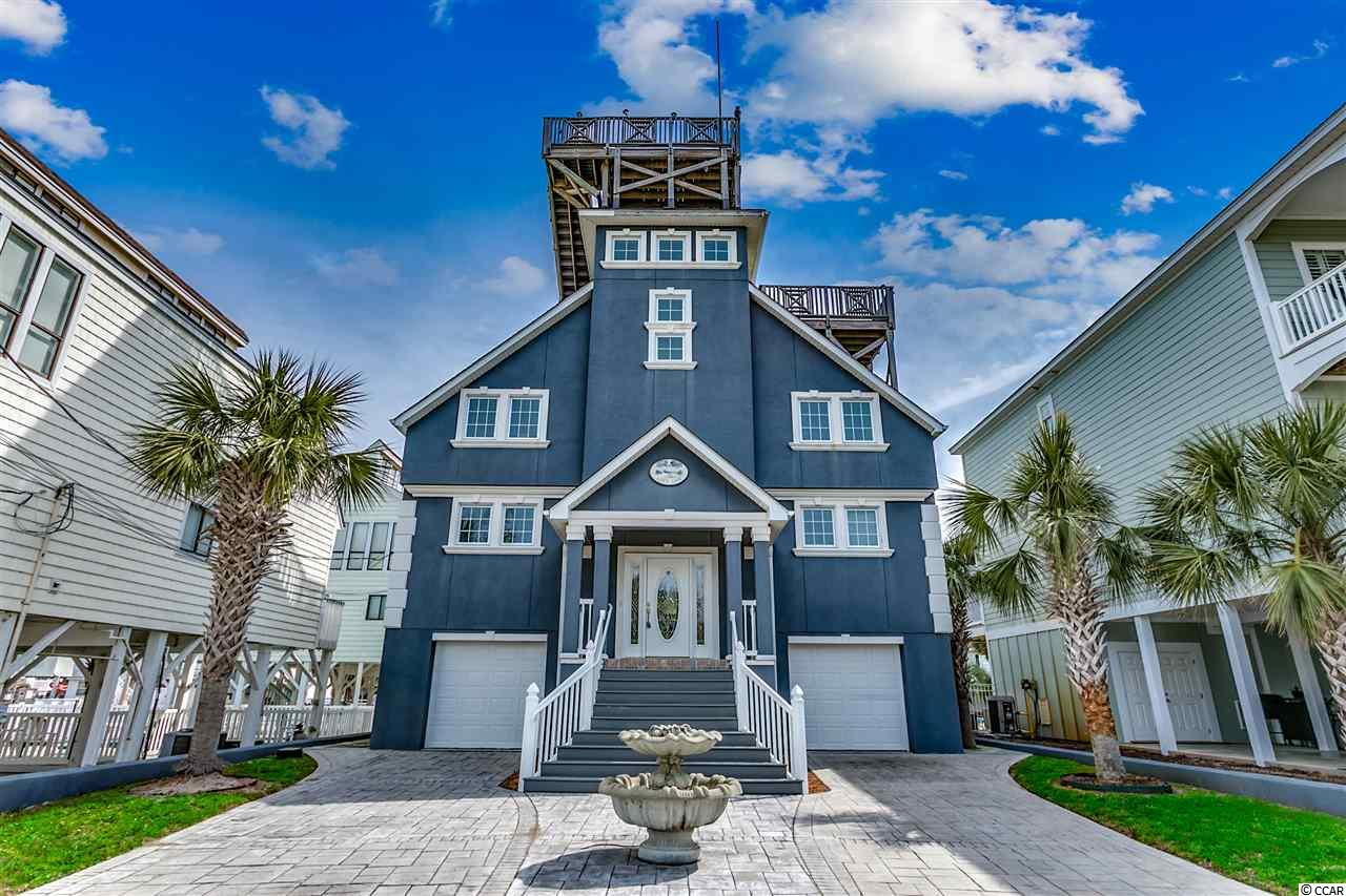 Come and view this Custom Built Beach Home with inground pool in the family friendly Cherry Grove Beach!  This unique home has  a widows watch which allows for amazing panoramic views and is only a 1/2 block to the white sandy beaches.  Home has been used as a second home and boasts all the upgrades you normally don't find.  Home features include  3 bedrooms, 3 full baths, a 4th shower on garage level, new furniture, fresh paint, hard wood floors, custom volume ceilings and much much more.  This spectacular home towers over all the others and offers the best views from the private roof top deck.  Make sure you take a chance to view this home, it is a must see!  Seller says bring offer!