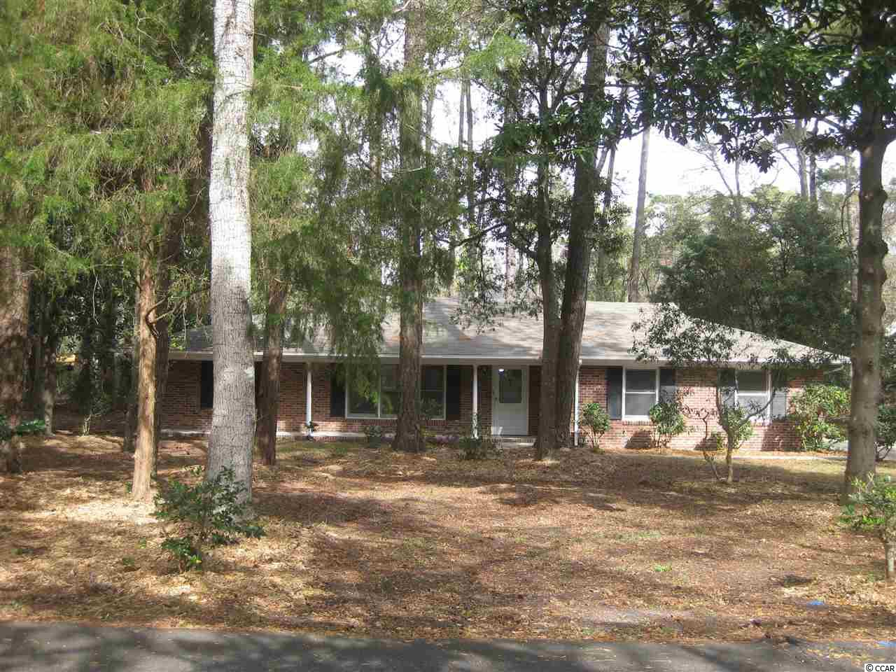 Location! Location! Location!All brick home in exclusive Oceanfront Briarcliffe Acres is nested in beautiful wooded land! This two bedrooms, two baths with extra indoor shower room comes with a cozy living room with wood fireplace, a family room with built-in wood shelving, a specious kitchen with ample cabinetry and a breakfast area. There is also a two car attached garage, Carolina room and a Sunroom. The flooring is new throughout the house and is on 0.8 of an Acre which you can build a swimming pool or tennis court as you wish. Neighborhood offers over one mile of private Beach and an Oceanfront Cabana! There is a short drive to shopping, restaurants and entertainment! With a little TLC make this home a dream come true!