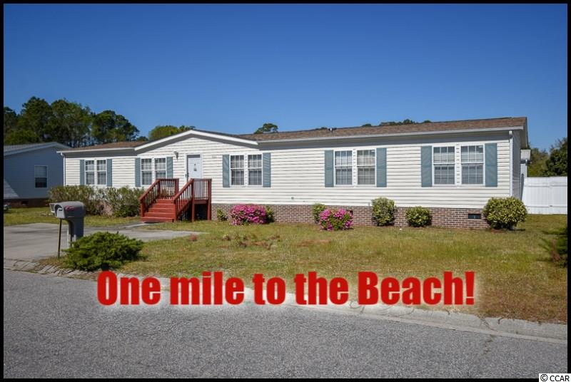 Are you ready for peaceful beach living?  This 5 bedroom, 3 full bath home is only 1 mile to the beach, and is being sold fully furnished, including a golf cart!  When you walk in you will notice there are two large living areas (one with fireplace), large kitchen with bar, and a fenced in backyard with over-sized back deck perfect for entertaining.  You will love the master bathroom which has a large soaking tub, an over-sized shower, separate vanity, and a sitting area.  Don't miss out on this great opportunity to own a place at the beach!  Verification of all measurements is the responsibility of the buyer.