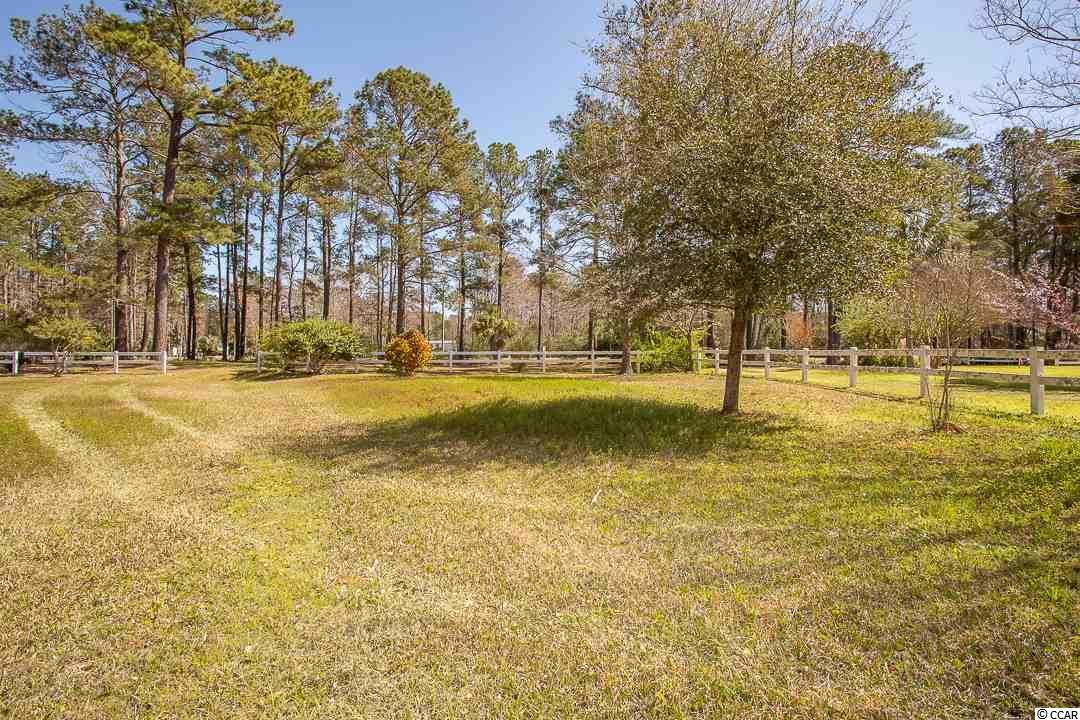 Beautiful 1 acre homesite with mature tress and beautiful flowering plants. Very private area and overlooks a pond.