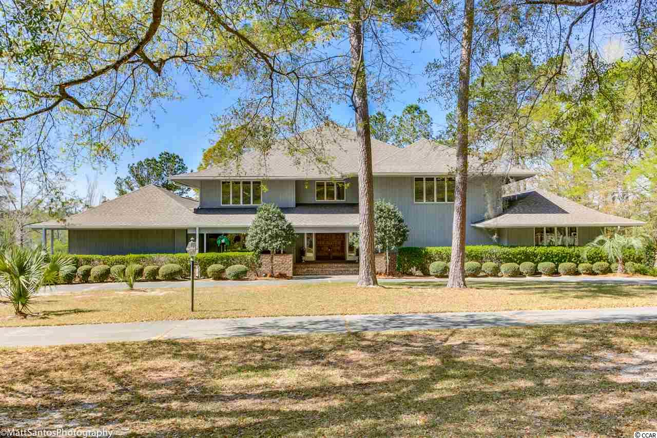 "If you are looking for your forever home look no further!This beautiful 7 bedroom 4.5 bath home on 2 acres situated on a high bluff over looking Black River with access to the Intracoastal Waterway and the Atlantic Ocean. There is no shortage on the memories you can make with friends and family. The immaculately maintained home has its very own private dock with electricity and running water which is perfect for cleaning the catch of the day. Sit back and relax in the private gazebo while  you take in all of the laughter of the children playing in the large in-ground pool. For your convenience there is a detached pool house with ample storage for all of the pool floats  and outdoor games. When its dinner time, no need to go inside,Enjoy the  food and the water views while cooking on the double brick barbecue with a beautiful copper hood coated with patina! Once you walk into the home entering through the grand foyer, you will feel right at home. Gorgeous hardwood floors flow through the open living room  that you wouldn't believe unless you see it for yourself!This room overlooks the pool and river and features a cathedral ceiling and a two-story brick fireplace. The Carolina Room boasts of solid Cypress paneling from floor to ceiling. Nearby is a full bath and laundry room with an oversized pantry to store all of the goodies! They say that the kitchen is the heart of the home and with this home it holds true, with corian countertops, new appliances and a breakfast bar where the family can gather to talk about their daily plans! Host all of the Holiday gatherings in the large formal dining room. The large Master bedroom features a sitting area and private bath. Two large bedrooms located downstairs share a Jack and Jill bathroom that has  double sinks, soaking tub with a separate shower which is perfect for your overnight quests. Four other bedrooms are located upstairs, two of the four have access to the upstairs balcony that also overlooks the river and pool. No expenses were spared with this home! On top of everything else, there is a surround sound system, security system, central vacuum, 3rd floor 22"" by 24"" recreation room, lounge room with a full bar that has a sink and ice maker. Wait there's more, not only does the pool have a diving board and slide, but there is a 6-person Jacuzzi as well! Park your motorcycles, golf carts , or you classic car in the 3 car garage after finding your way through the two secured iron gates, down the circular drive.  You really can't even put this house into words. It's something that you have to see for yourself, so don't miss out! Book a showing today!"