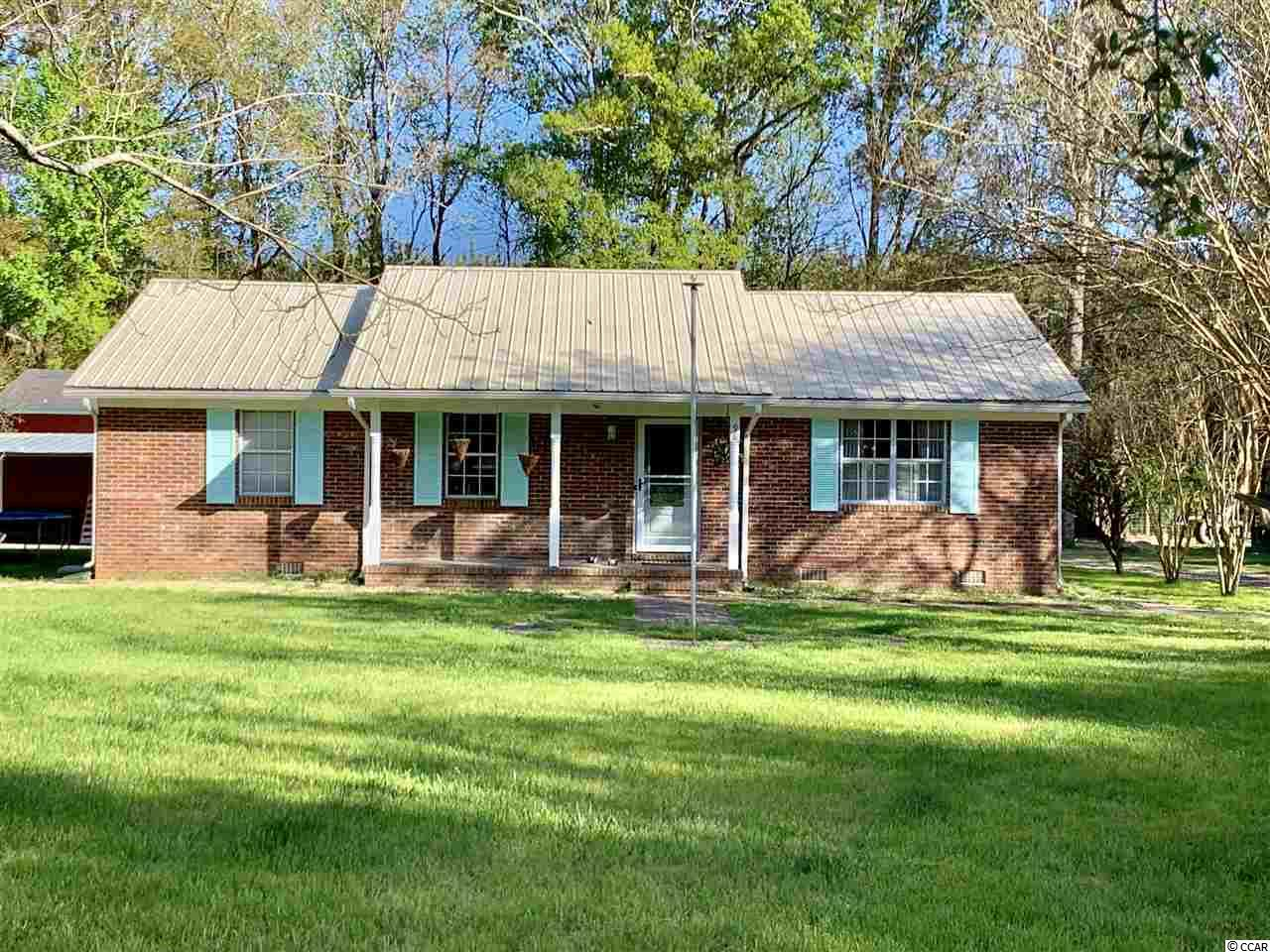 This is a well maintained brick home on a large lot. Owners have done the upgrades so this one is move in ready. On the property you will find a large shed, several chicken coops, a large treehouse, more chicken coops, above ground pool and a garden that is ready to be planted. The main part of the shed is climate controlled. Also, attached to the shed is several stalls for equipment or toys. This family use to raise chickens so the whole yard is fenced in. Some of the upgrades that have been done are: concrete counter tops in the kitchen, stainless steel appliances, Luxury vinyl plank flooring, encapsulation with dehumidifier in the crawlspace and a metal roof. This one won't last long!!